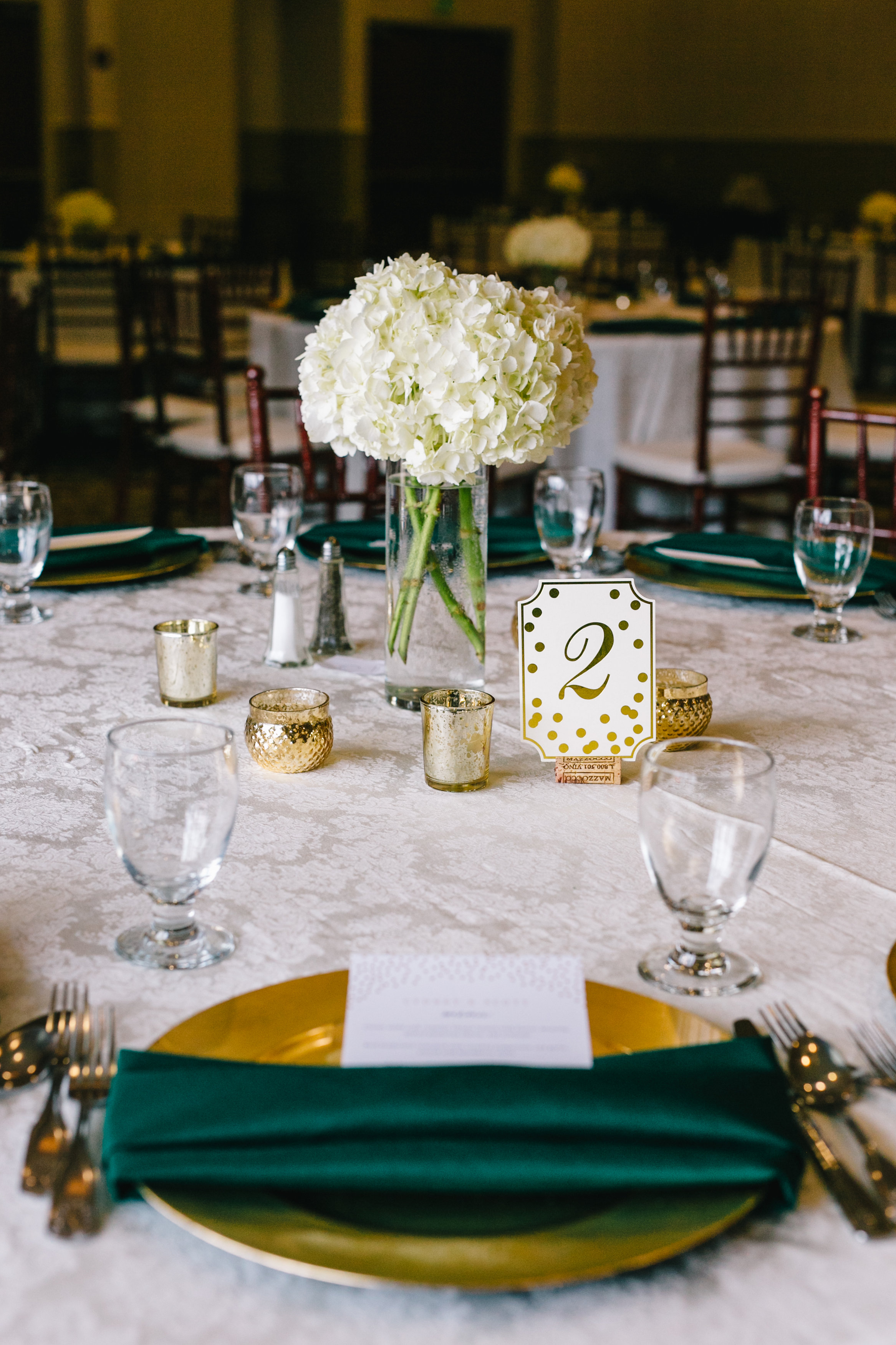 Emerald, gold and ivory reception placesettings