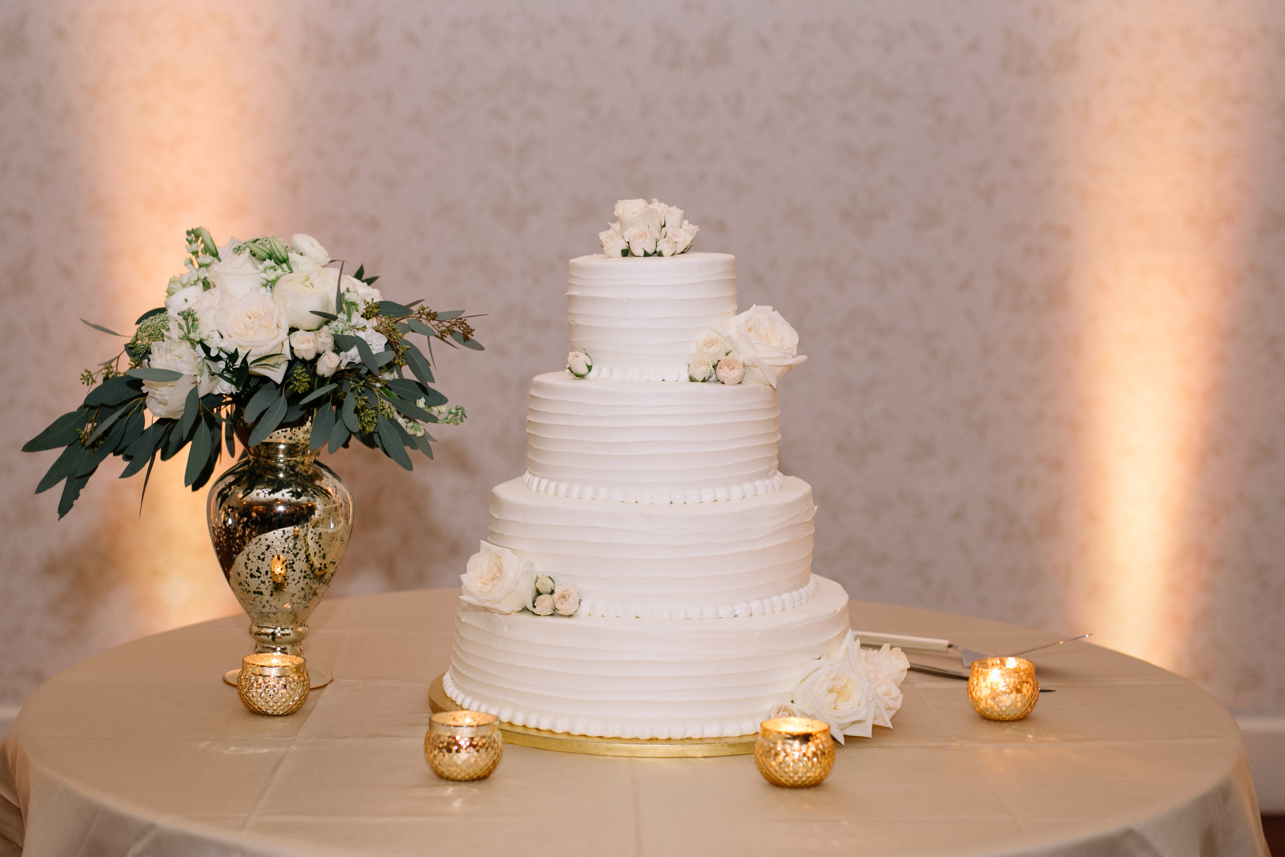Four tier wedding cake with garden roses