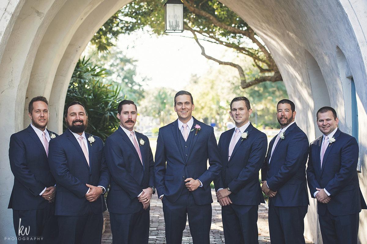 Groom and groomsmen in navy suits at Casa Feliz wedding
