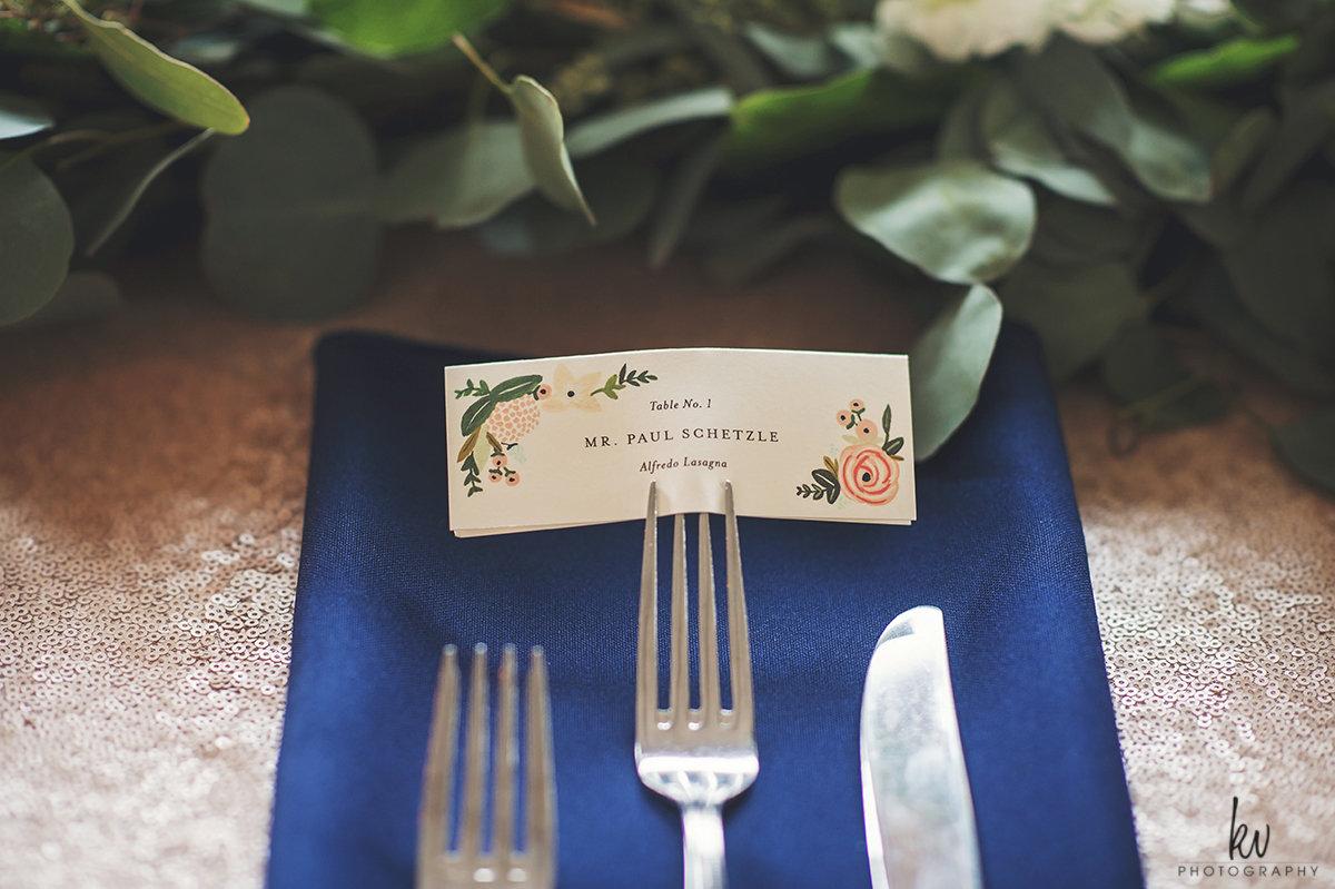 Custom menu card folded in blue linen napkins, wedding reception details