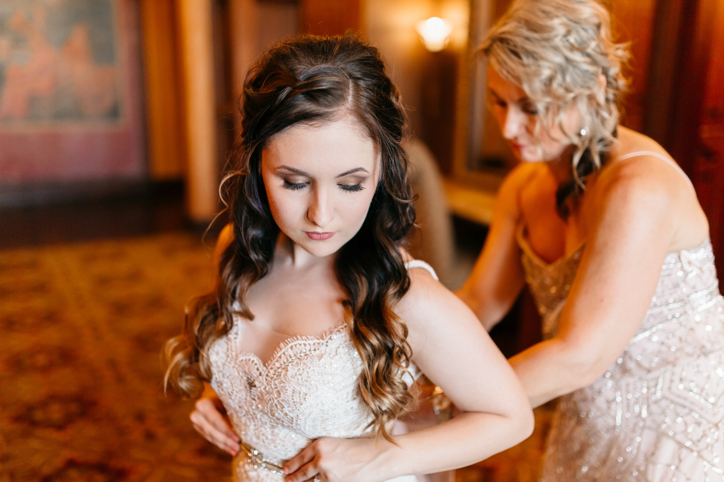 Sweet moments between a bride and her mother, Bella Collina bridal suite