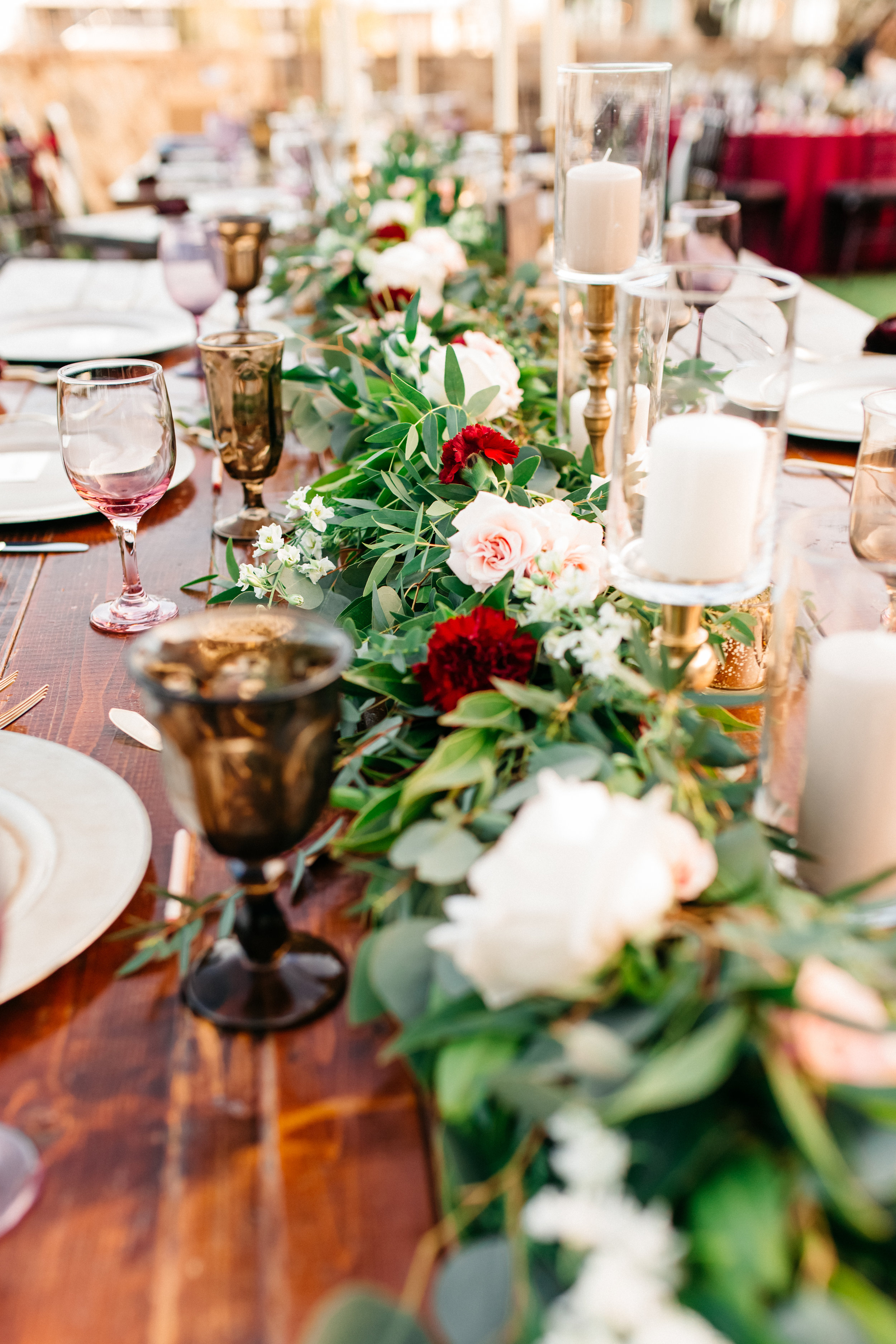 Garland centerpieces with deep red and blush garden roses