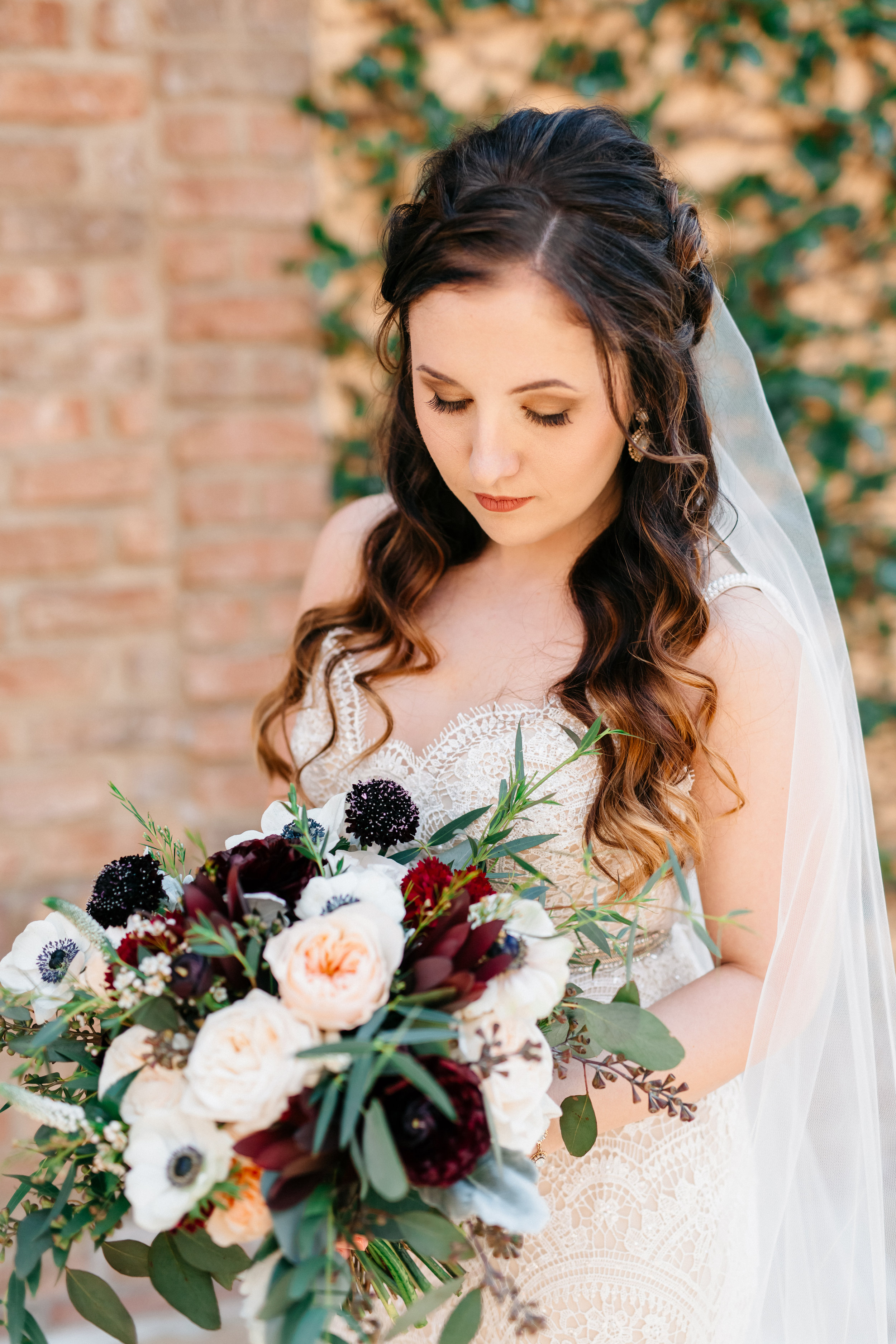 Bridal bouquet of anemones and blush peonies