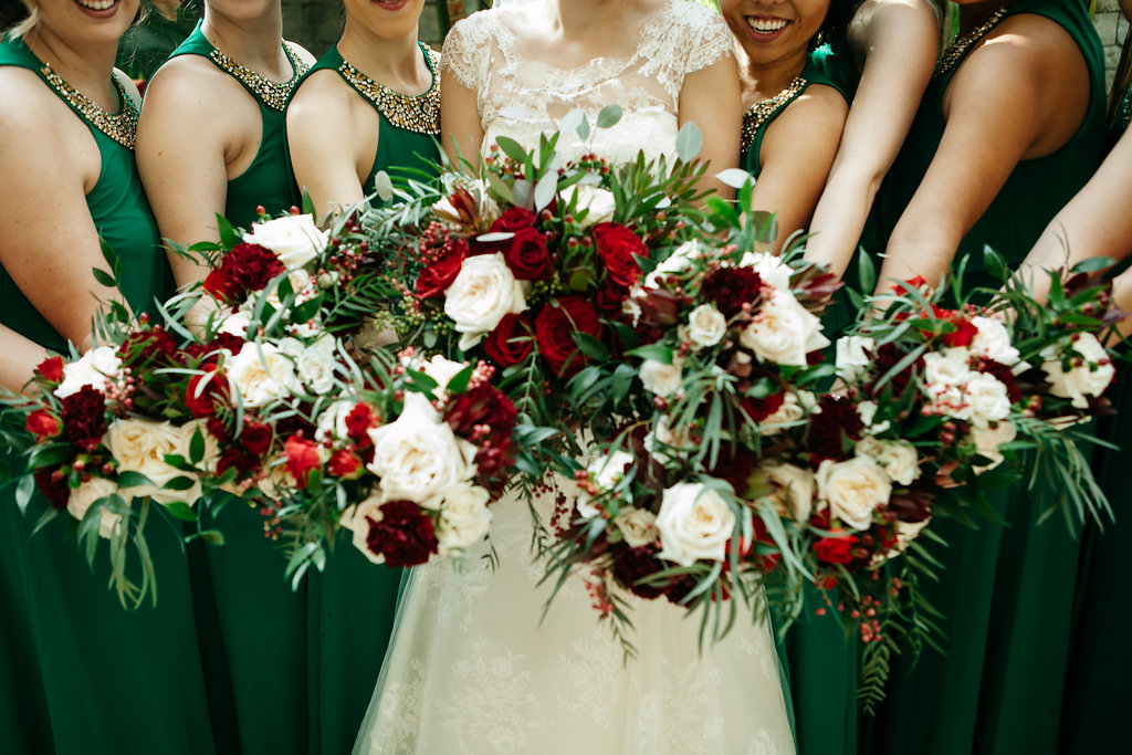 Gorgeous bouquets of red and white roses by Cloud 9