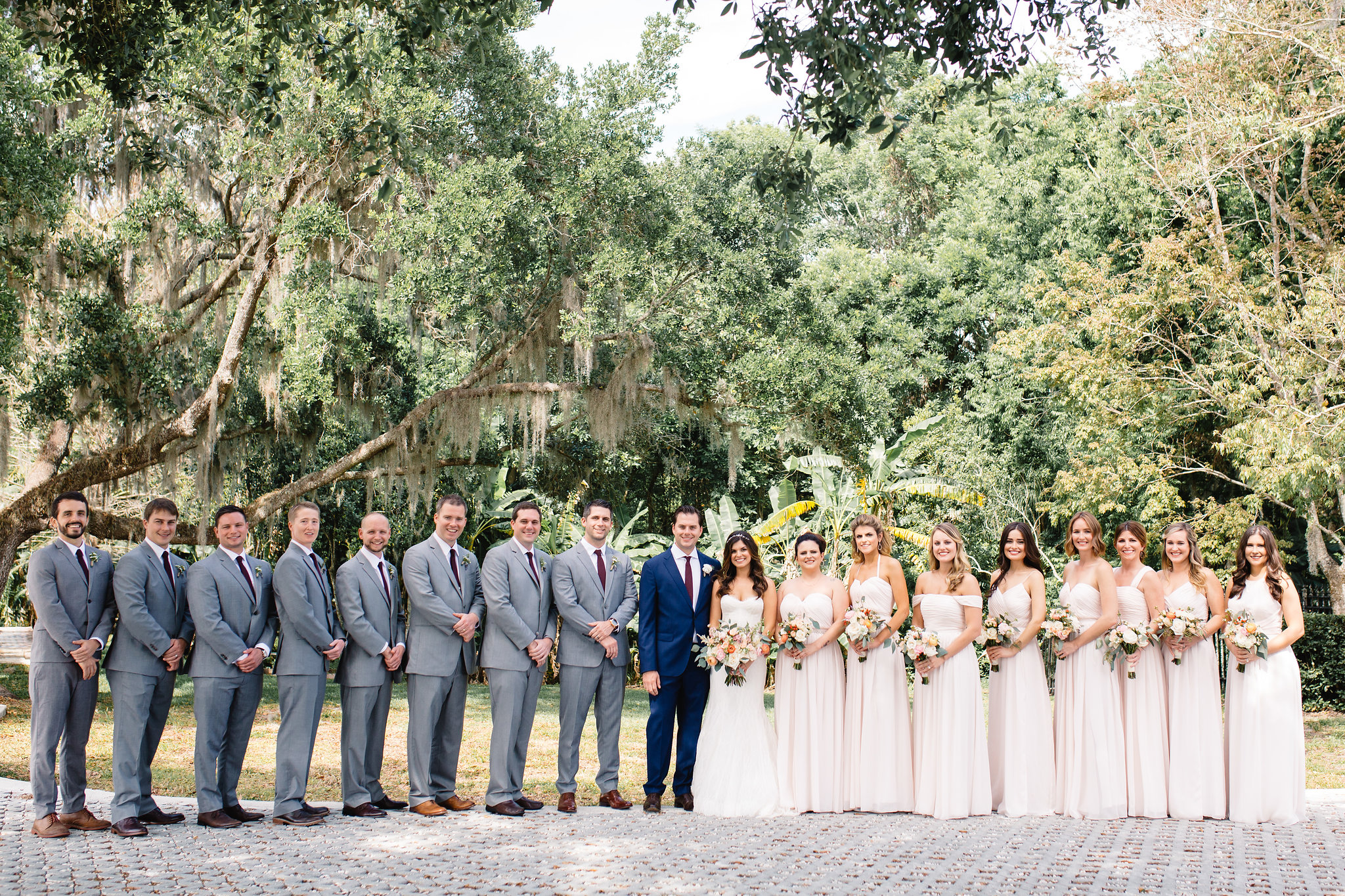 Grey and Navy Blue Suits and Blush Bridesmaids Dresses  Blush & White Garden wedding at Luxmore Grande Estate in Orlando, Florida  Orlando Wedding Planner Blue Ribbon Weddings  Orlando Wedding Photographer JP Pratt Photography  Wedding Ceremony & Reception at Luxmore Grande Estate
