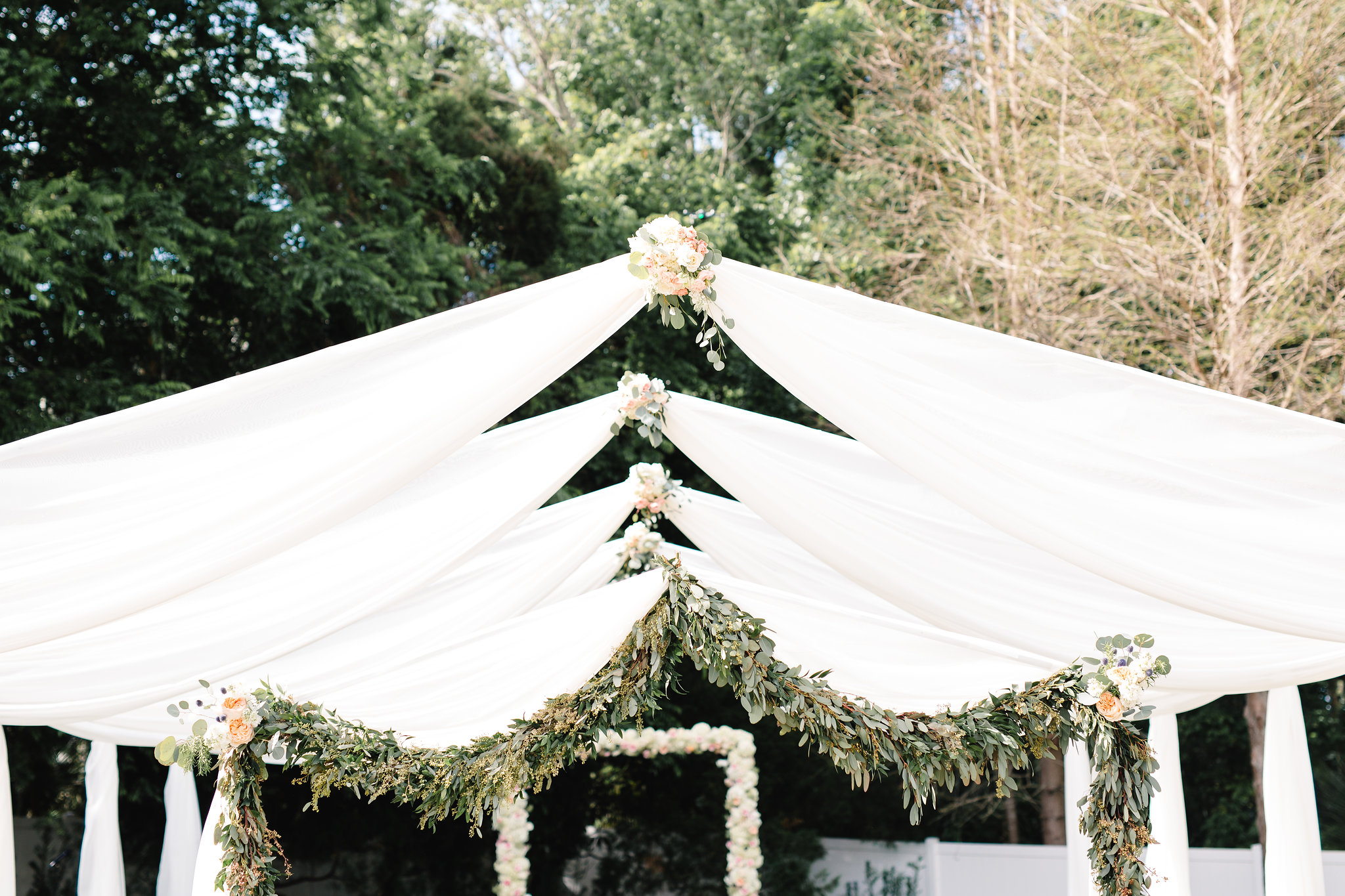 Arched ceremony draping with greenery  Blush & White Garden wedding at Luxmore Grande Estate in Orlando, Florida  Orlando Wedding Planner Blue Ribbon Weddings  Orlando Wedding Photographer JP Pratt Photography  Wedding Ceremony & Reception at Luxmore Grande Estate