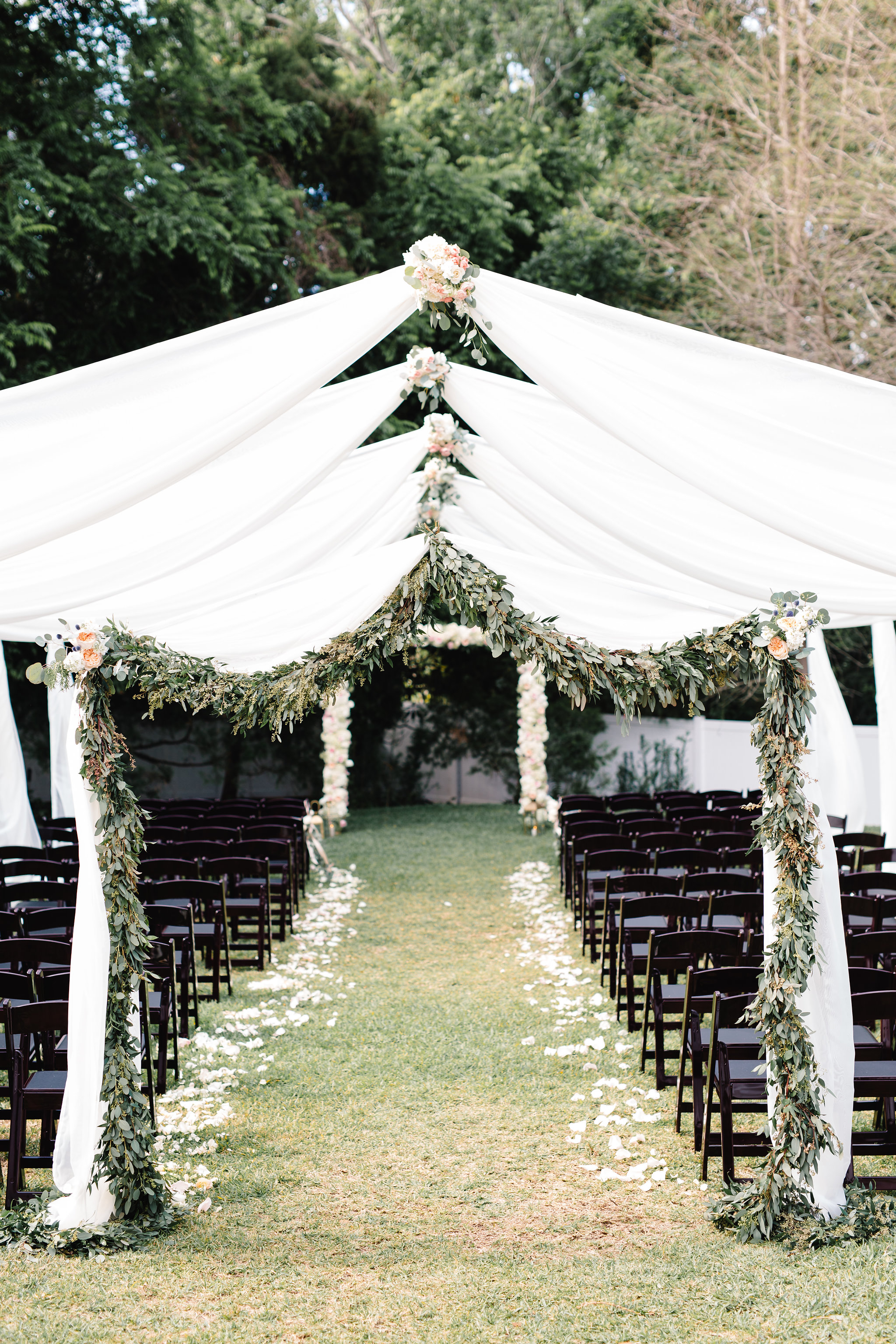 Arched ceremony draping with garland  Blush & White Garden wedding at Luxmore Grande Estate in Orlando, Florida  Orlando Wedding Planner Blue Ribbon Weddings  Orlando Wedding Photographer JP Pratt Photography  Wedding Ceremony & Reception at Luxmore Grande Estate