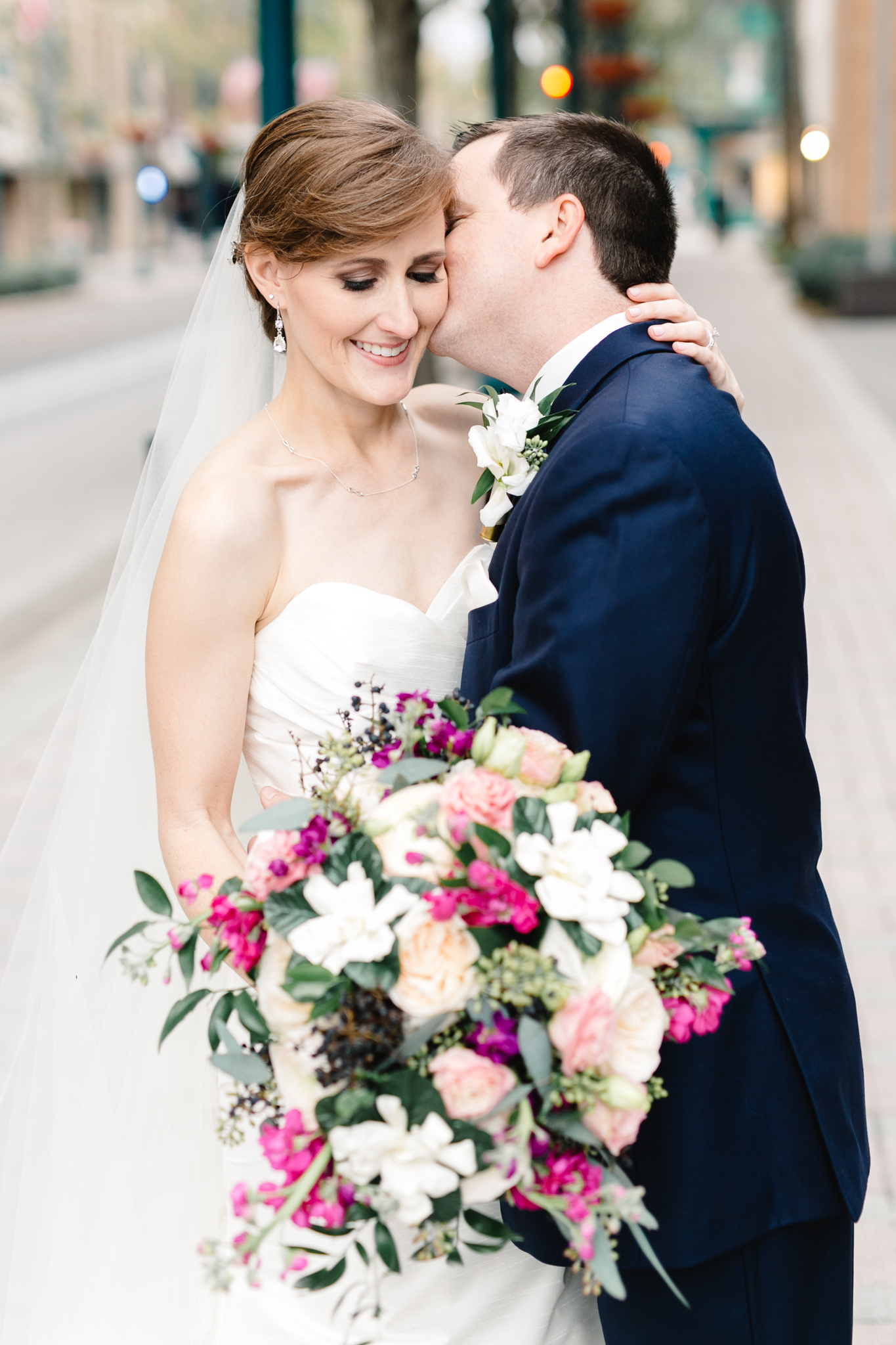 Sweet kisses from this Orlando Groom