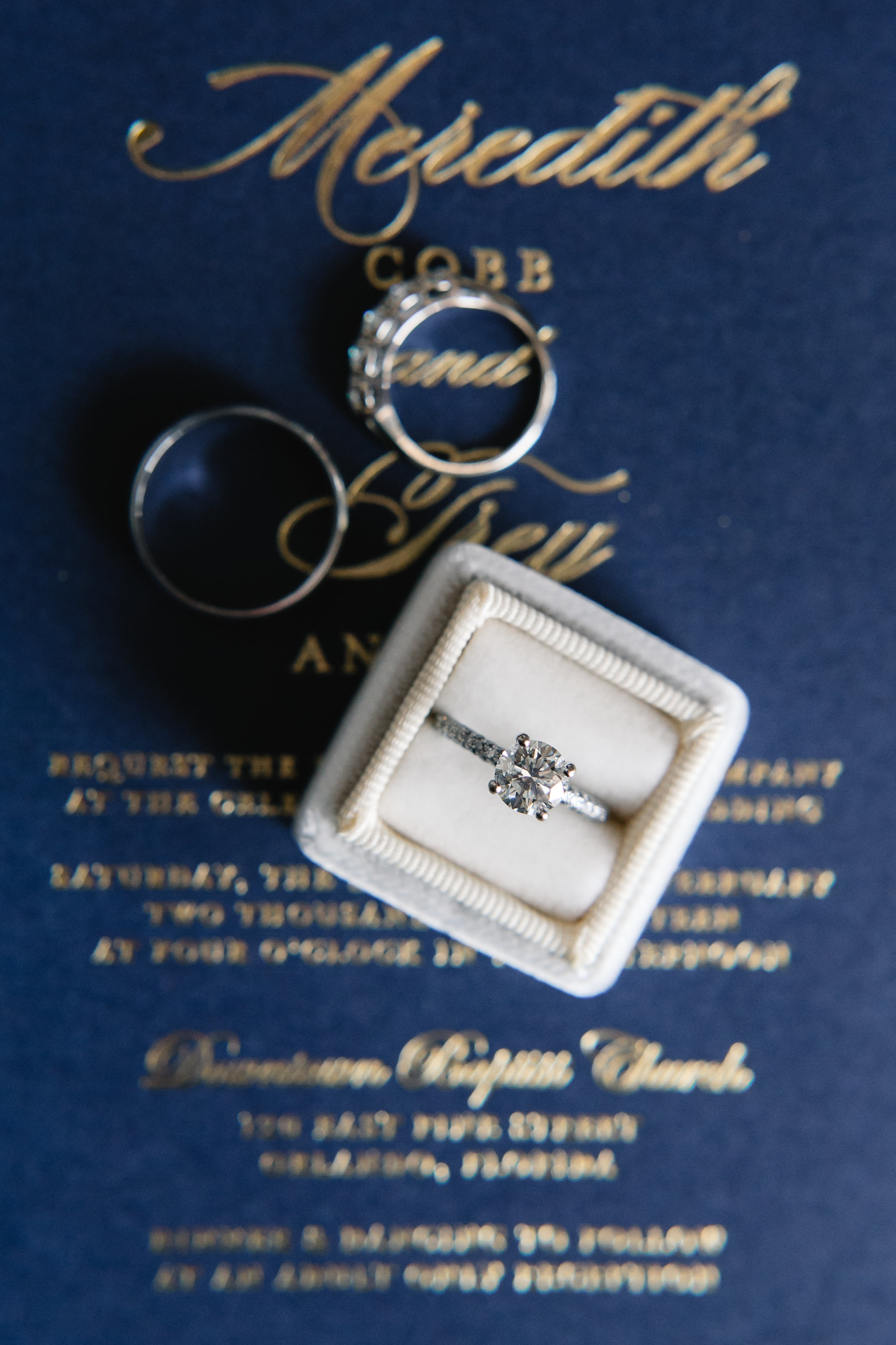 Styled detail picture of wedding rings with wedding details, Downtown wedding