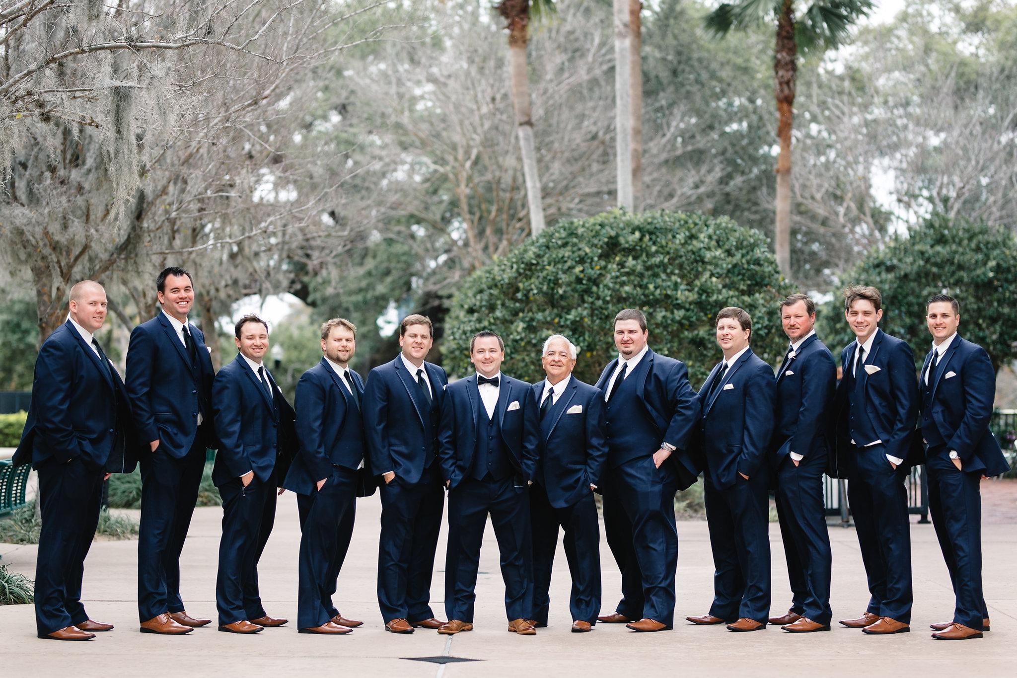 Trey and his groomsmen in navy suits