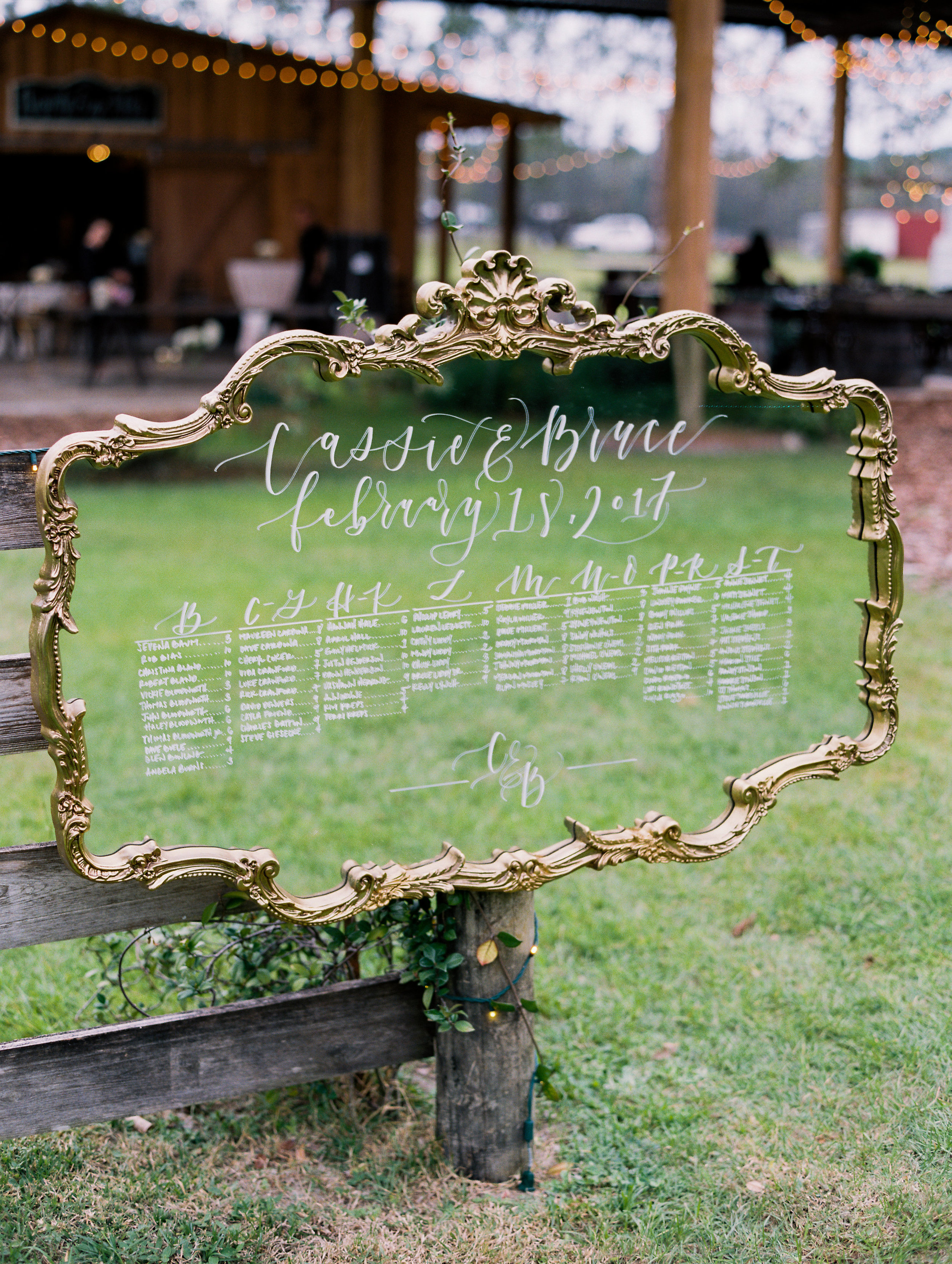 Gold framed mirror escort sign by Do Tell Calligraphy