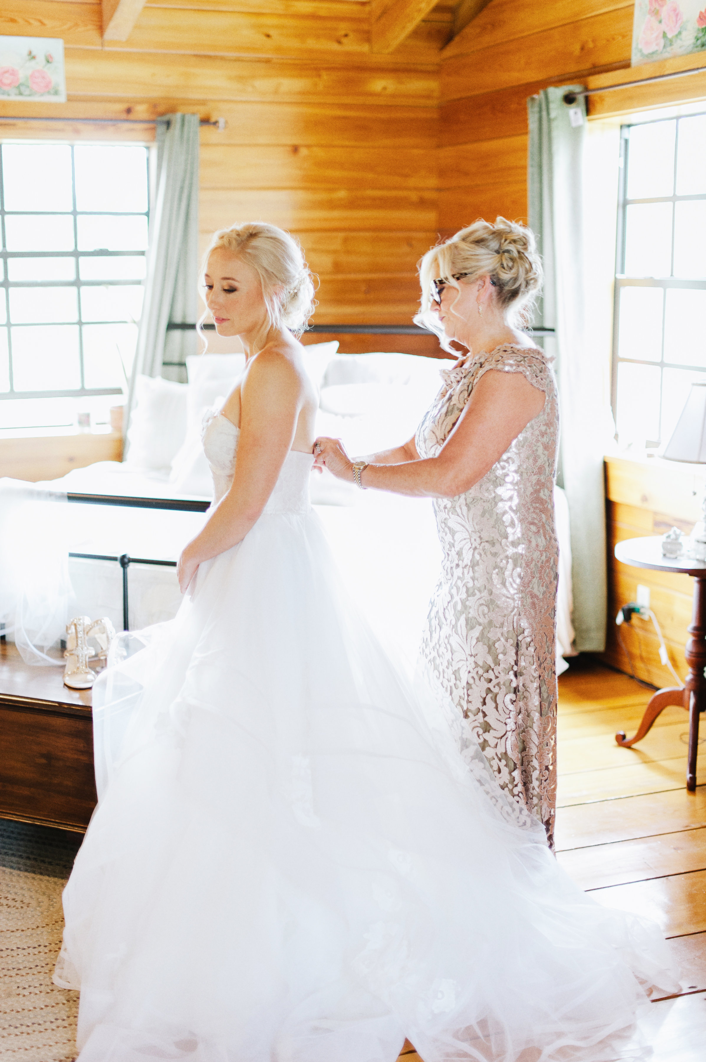 Sweet moments getting ready of bride and her mother
