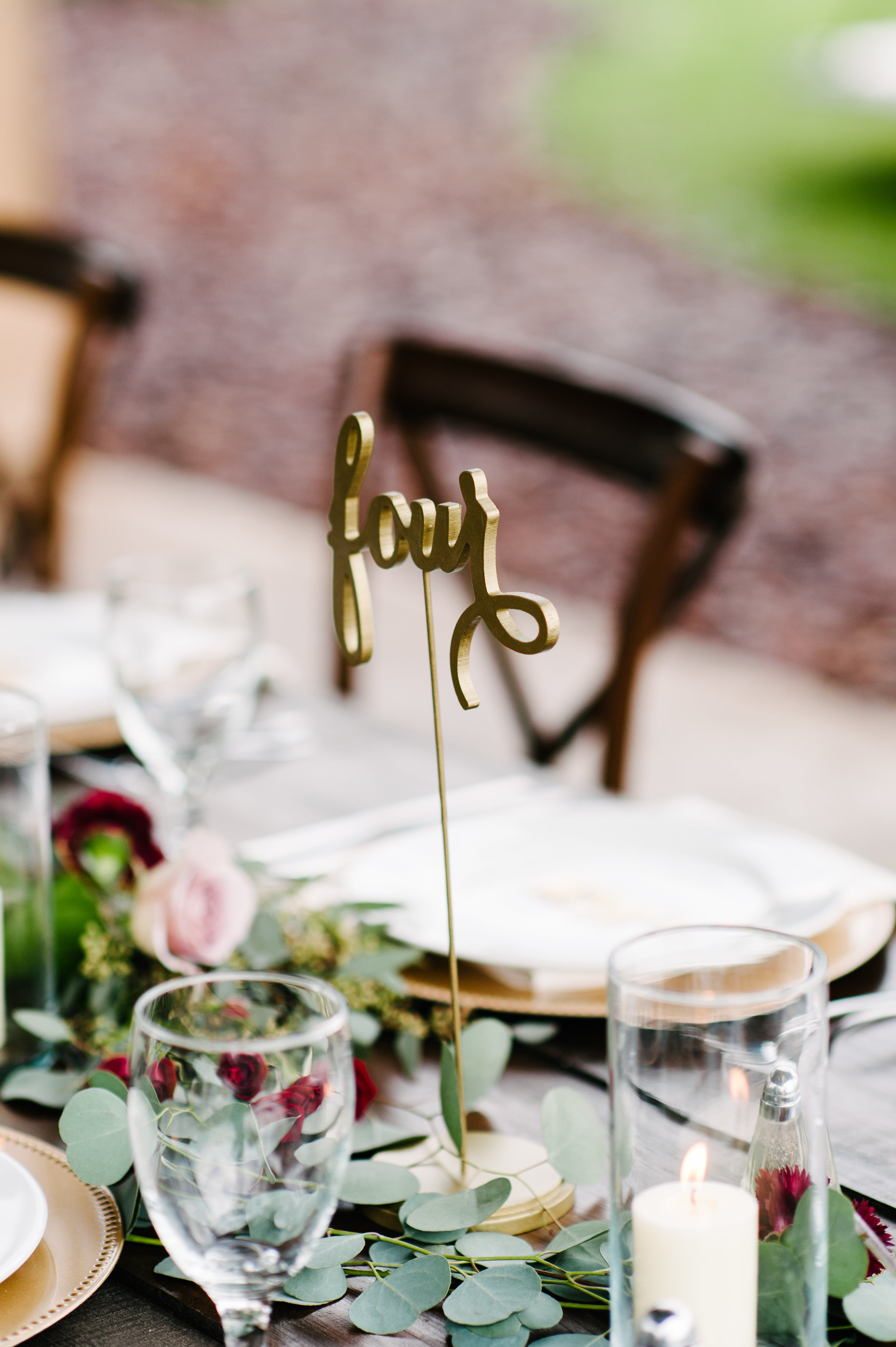 Cursive gold table numbers by Do Tell Calligraphy