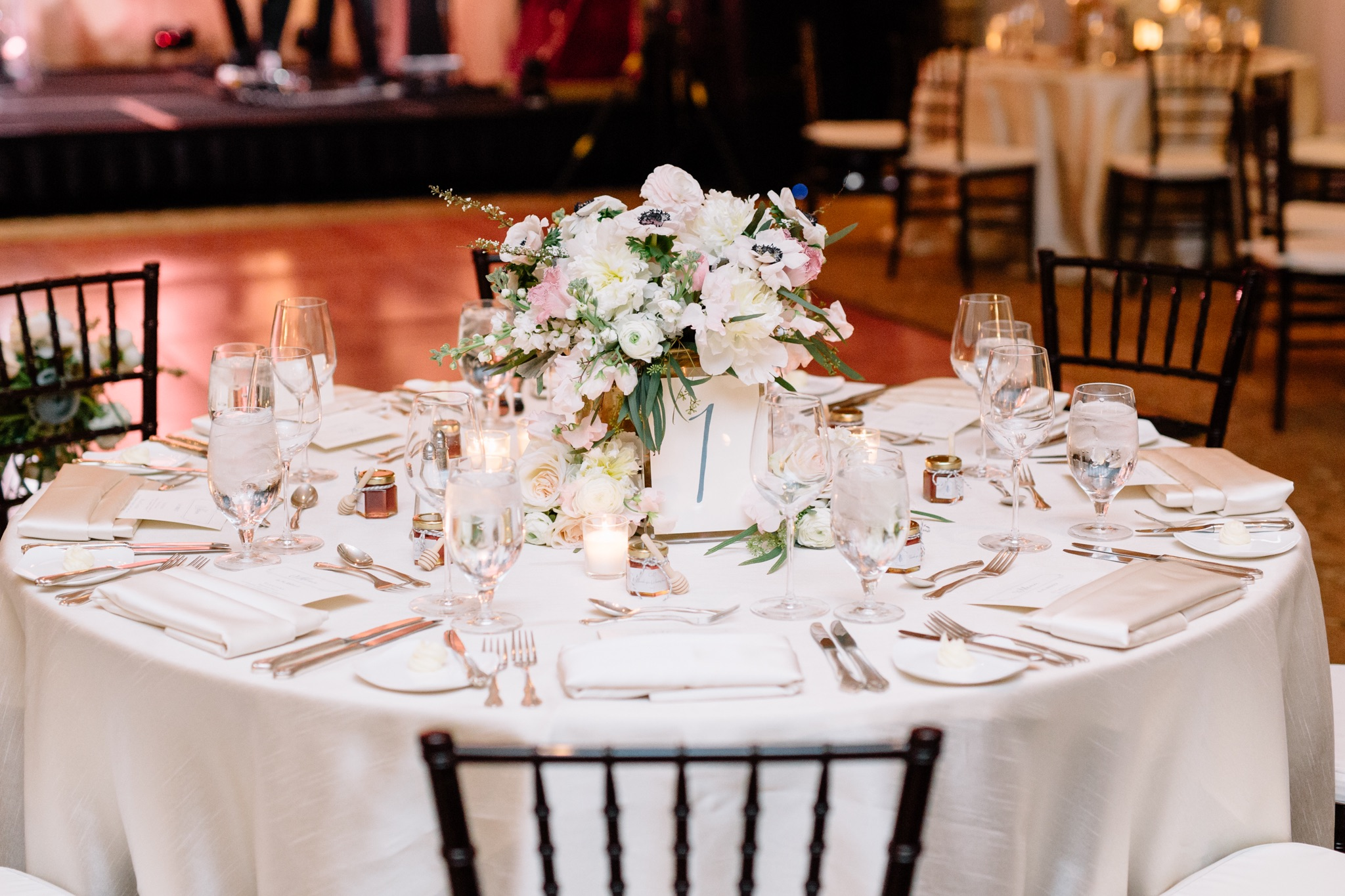 Floral centerpieces of hydrangea, blush and white roses