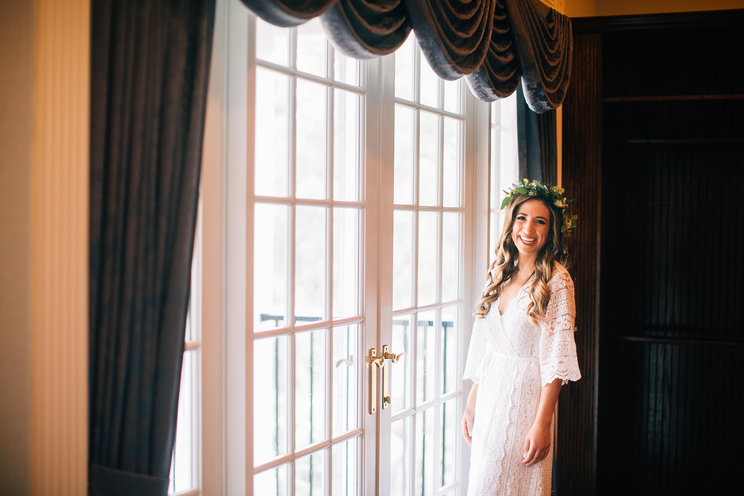 Bride in lace robe with flowercrown getting ready wedding photos Luxmore Grande Estate