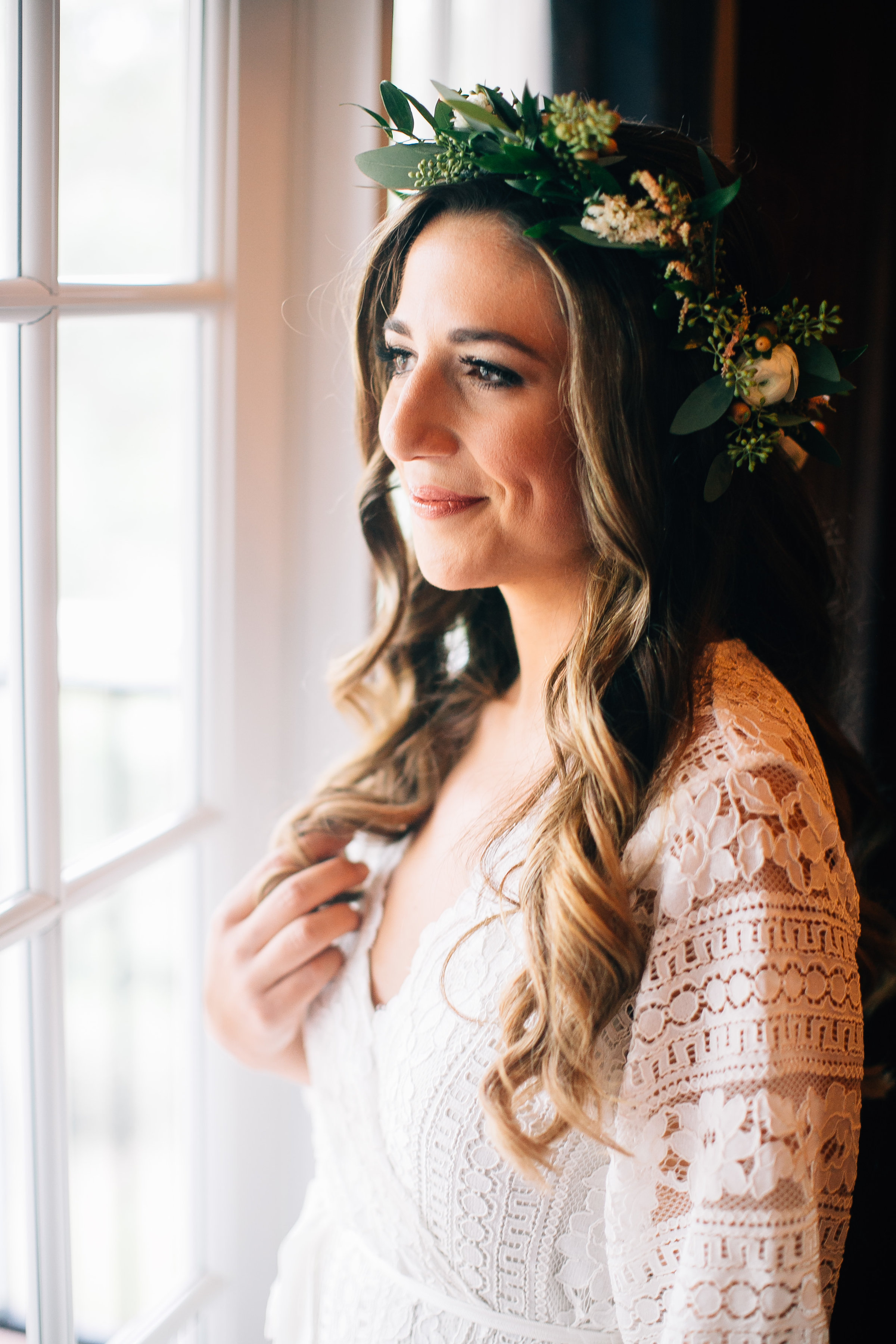 Bride in lace robe with flowercrown getting ready wedding photos