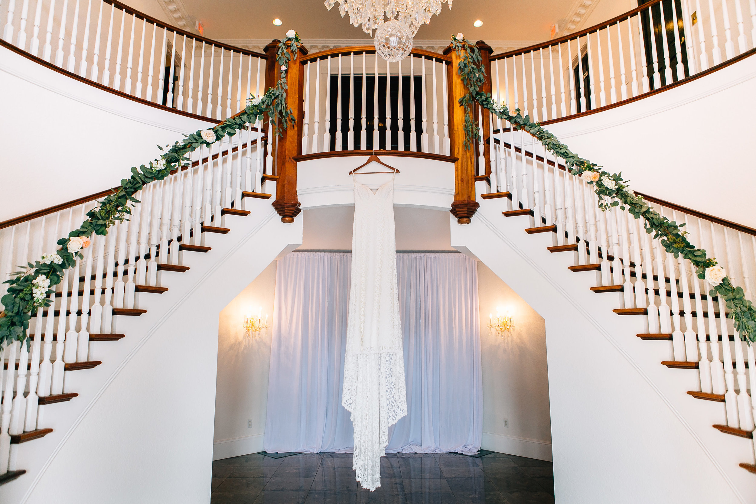 Luxmore Grande Estate wedding venue staircases with dress hung