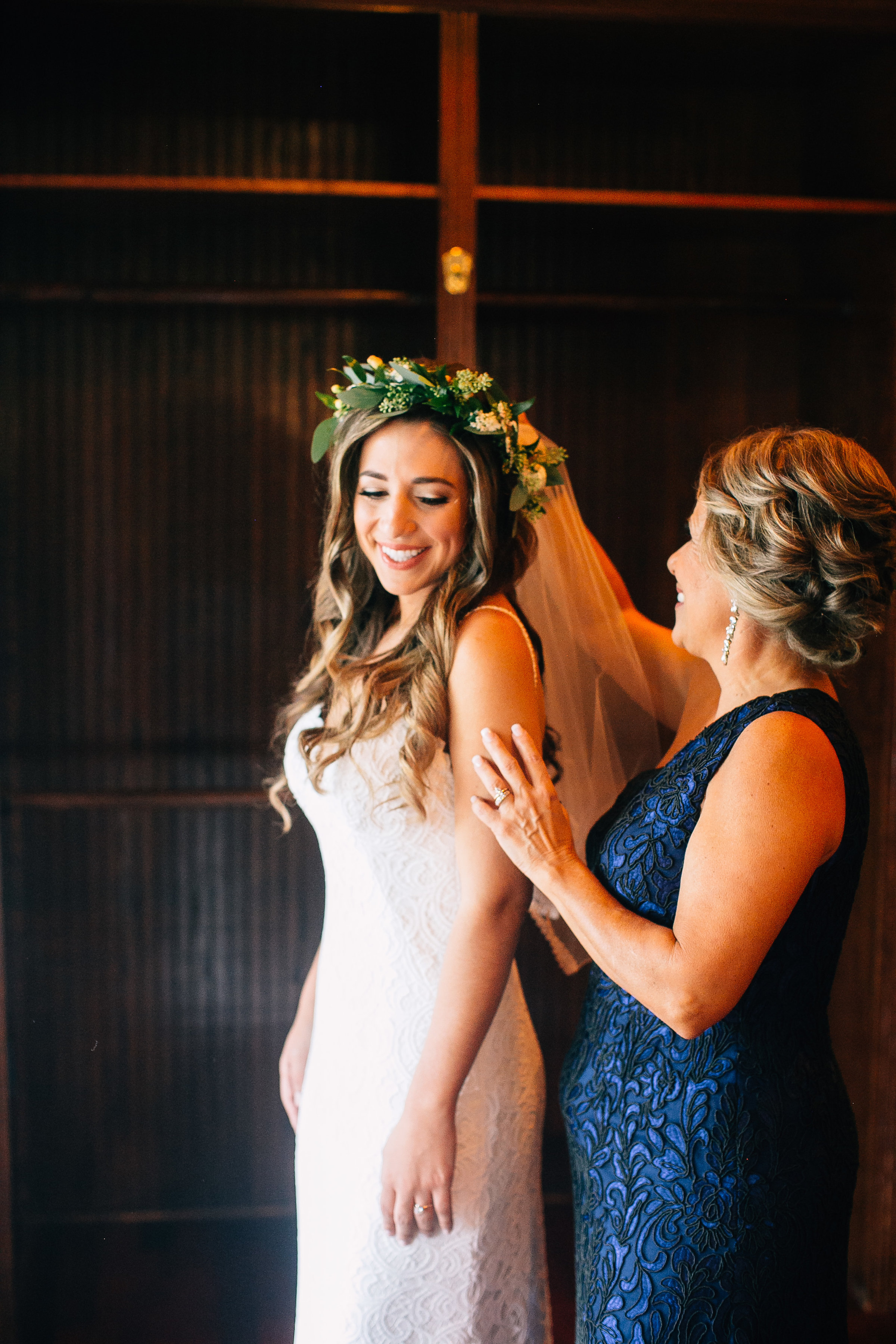 Bride with flowercrown getting dressed photos with mother of the bride