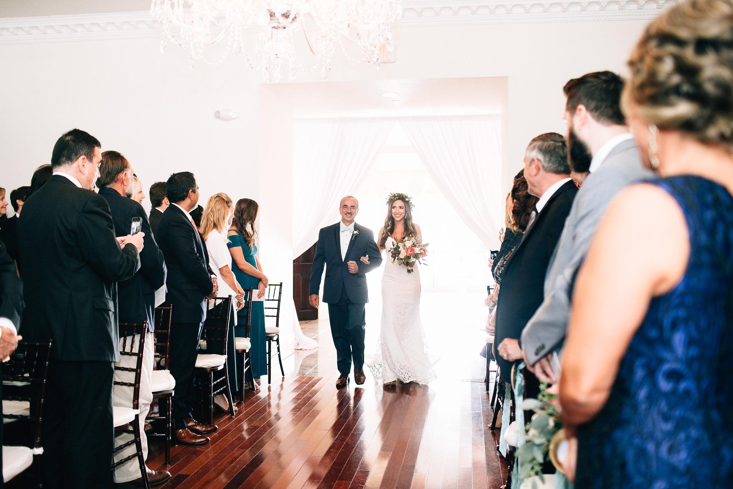 Bride's entrance indoor ceremony at Luxmore Grande, Orlando Wedding Planner