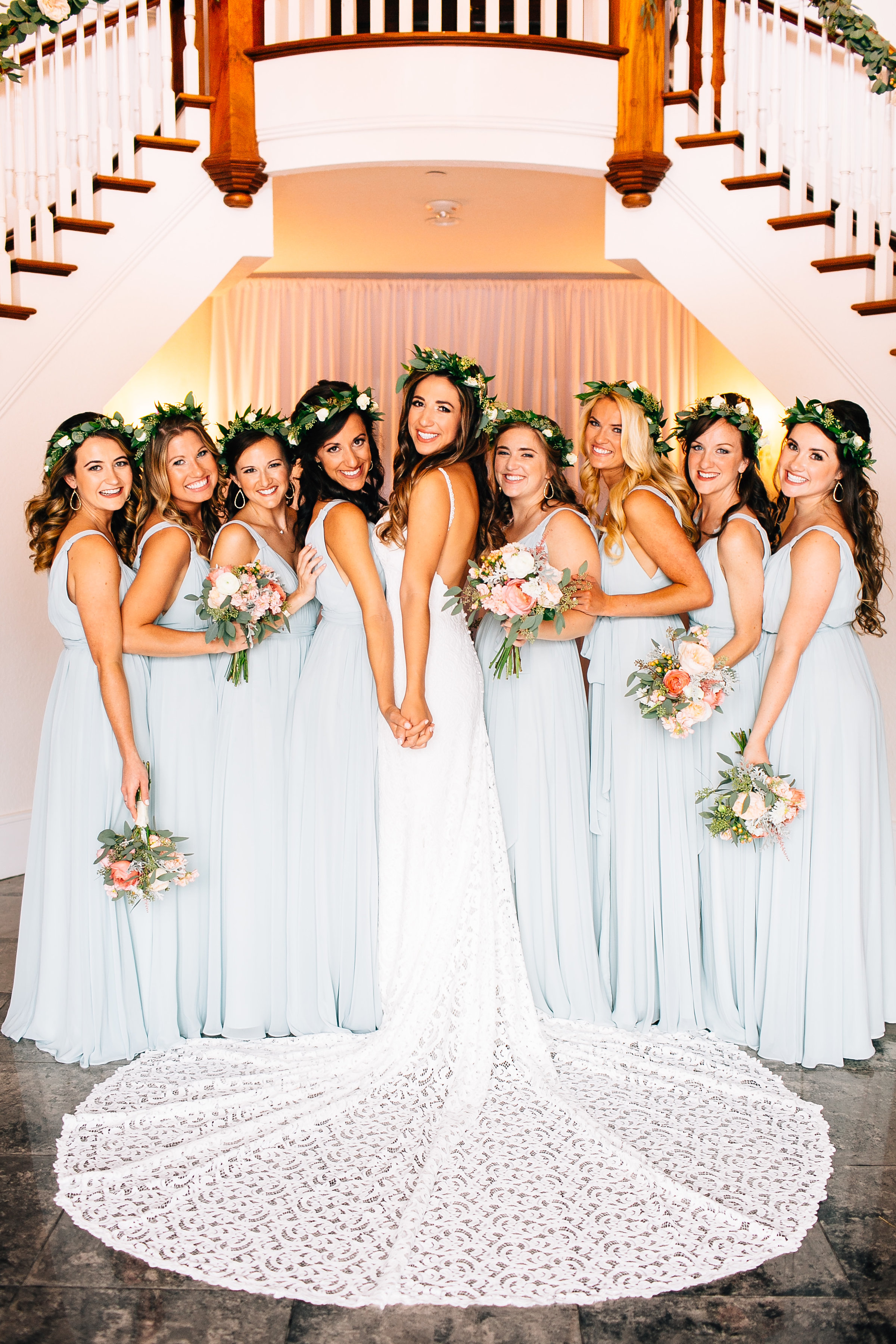 Indoor wedding Luxmore Grande, bridesmaids in sage dresses on staircase Orlando Wedding Planner Blue Ribbon Weddings