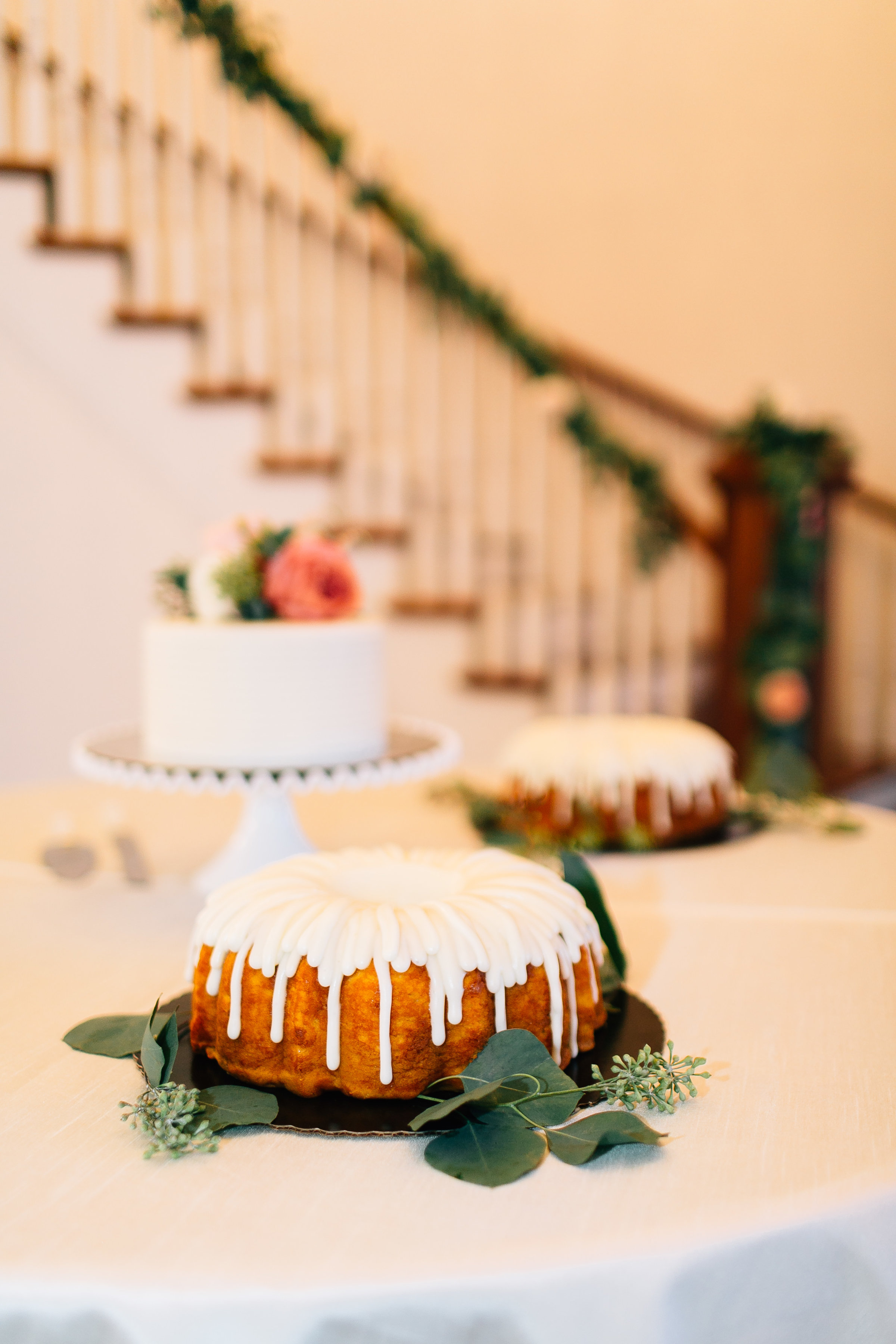 Wedding cakes at staircase at Luxmore Grande Estate styled by Orlando Wedding Planners