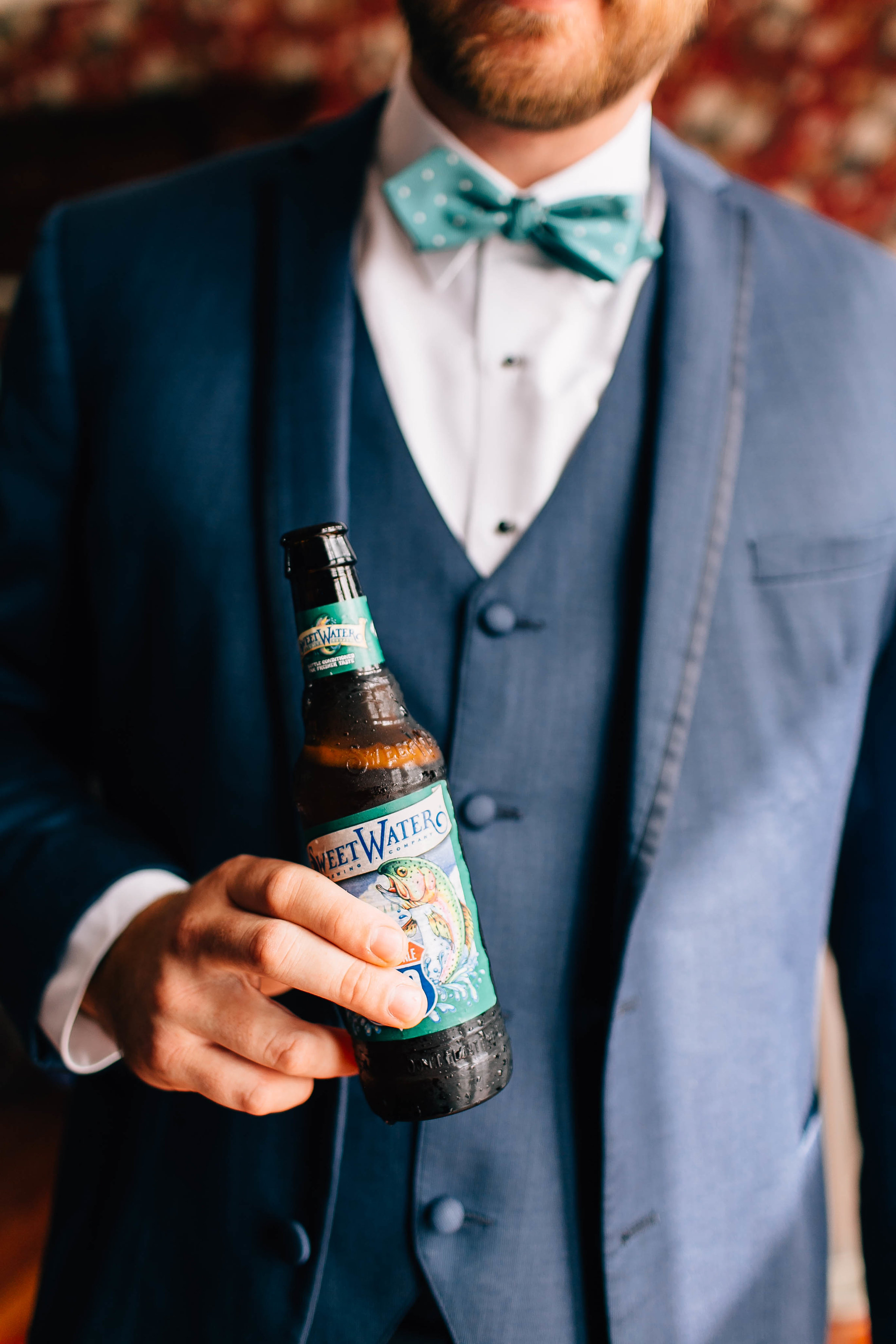 Groom with bowtie & Sweetwater Beer