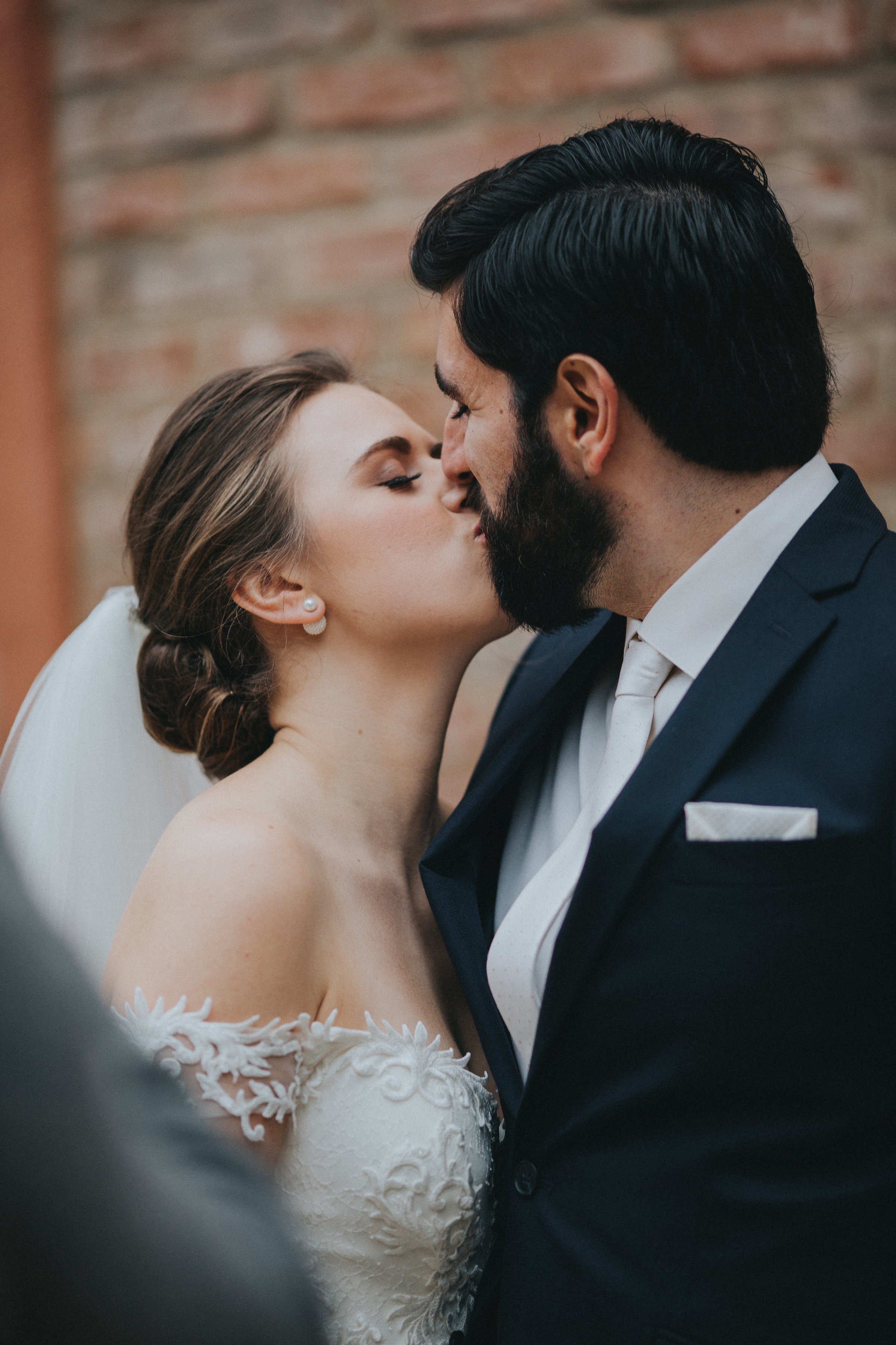 First of many wedding day kisses from the Bride and Groom