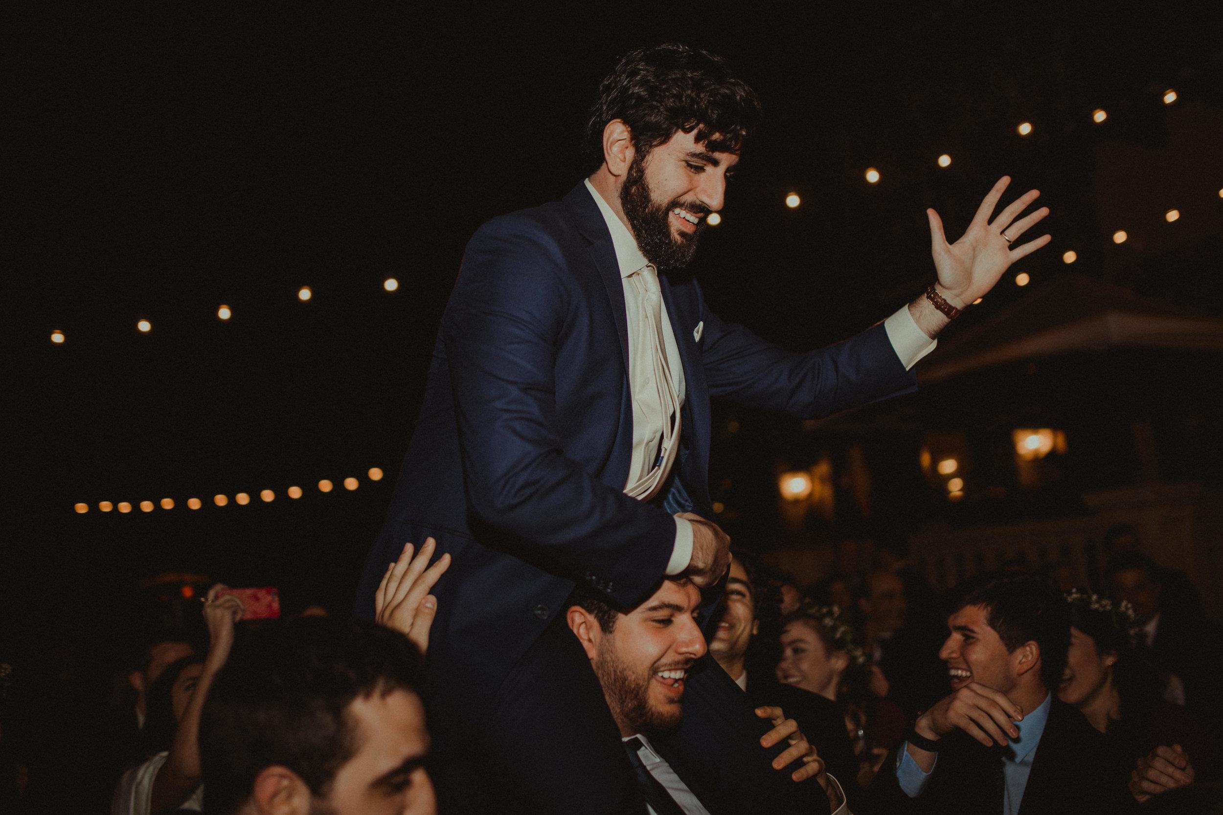 Wedding reception dancing under the market lights