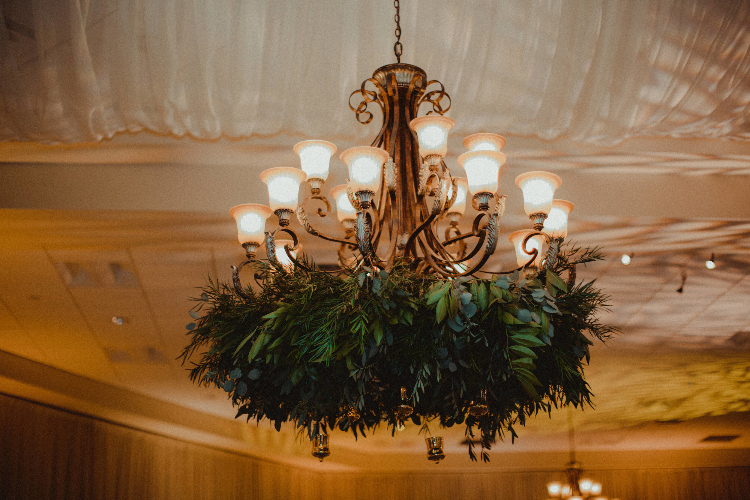Hanging chandeliers with garland