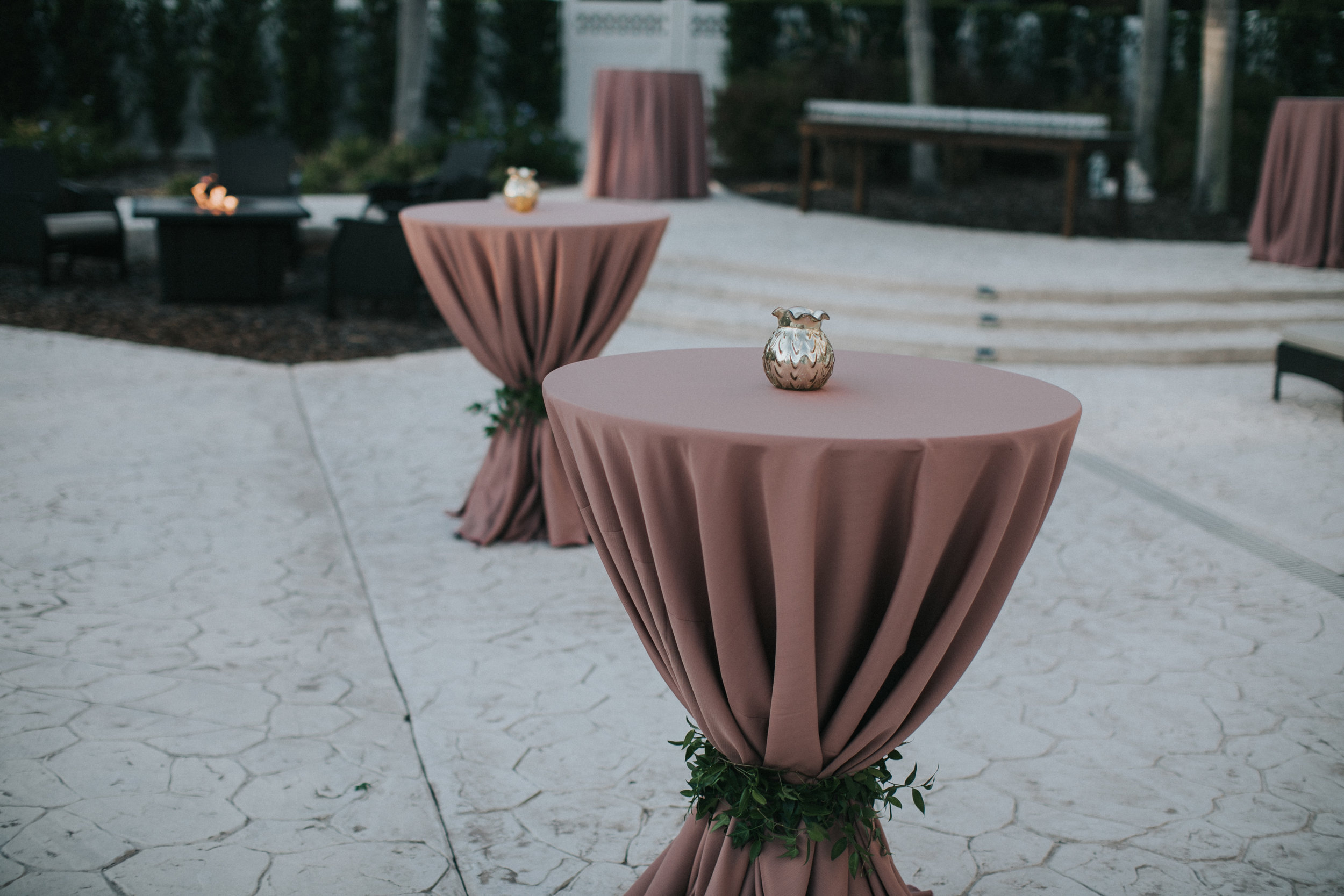 Cocktail tables with blush linens