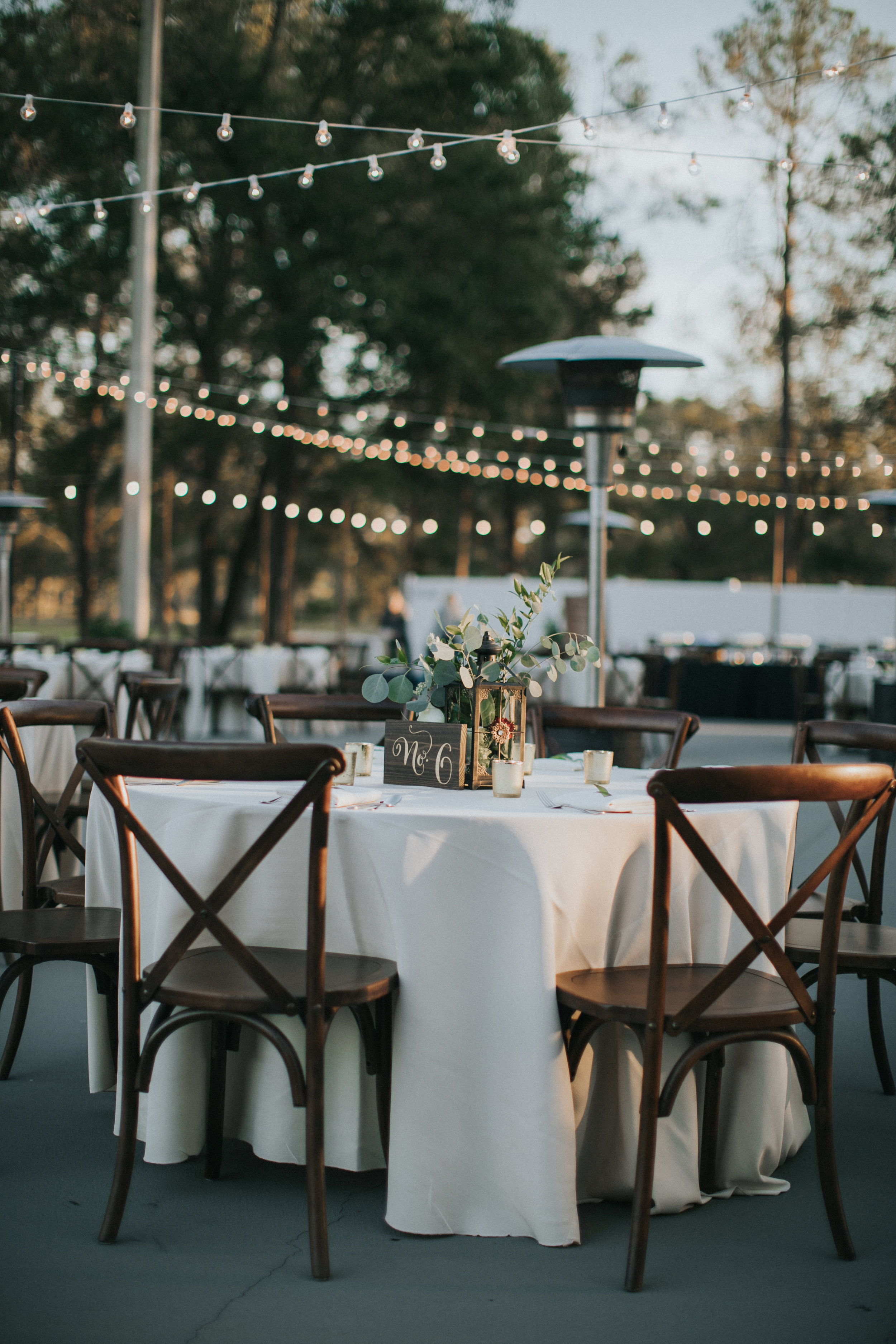Outdoor wedding reception with market lights