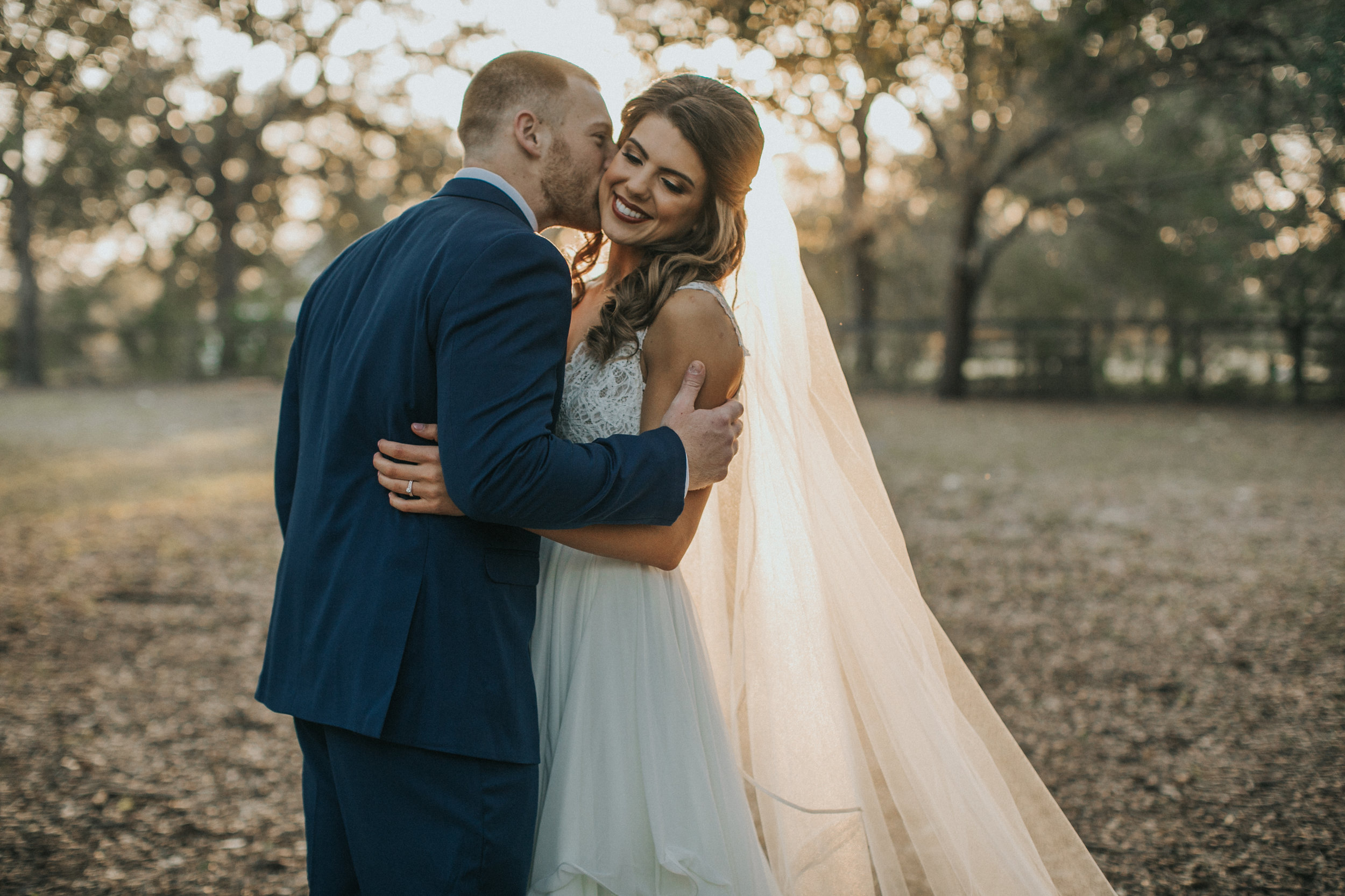 Sweet kisses from the groom to his bride