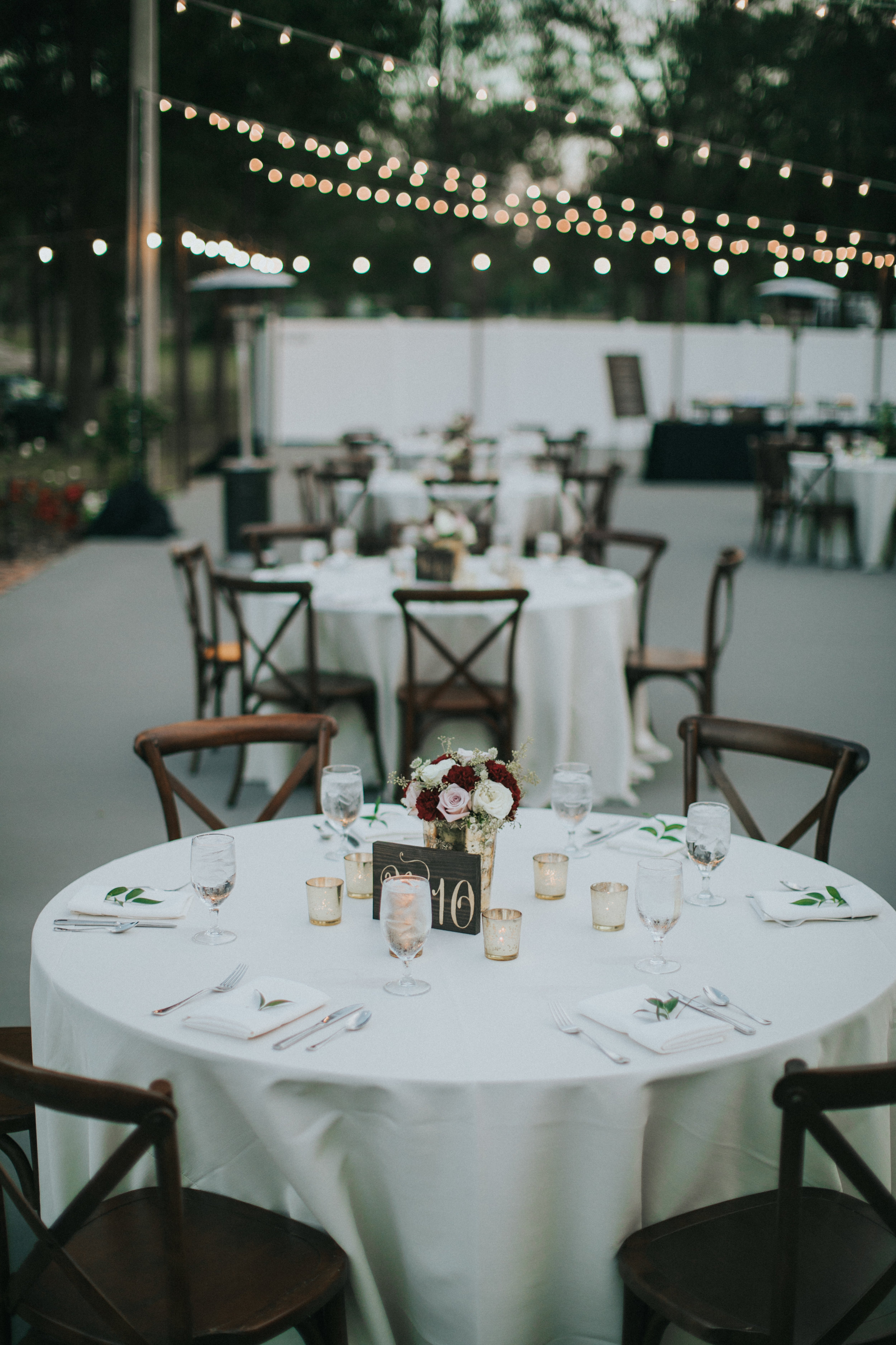 Wedding Reception round table with mercury gold candles and ivory linens