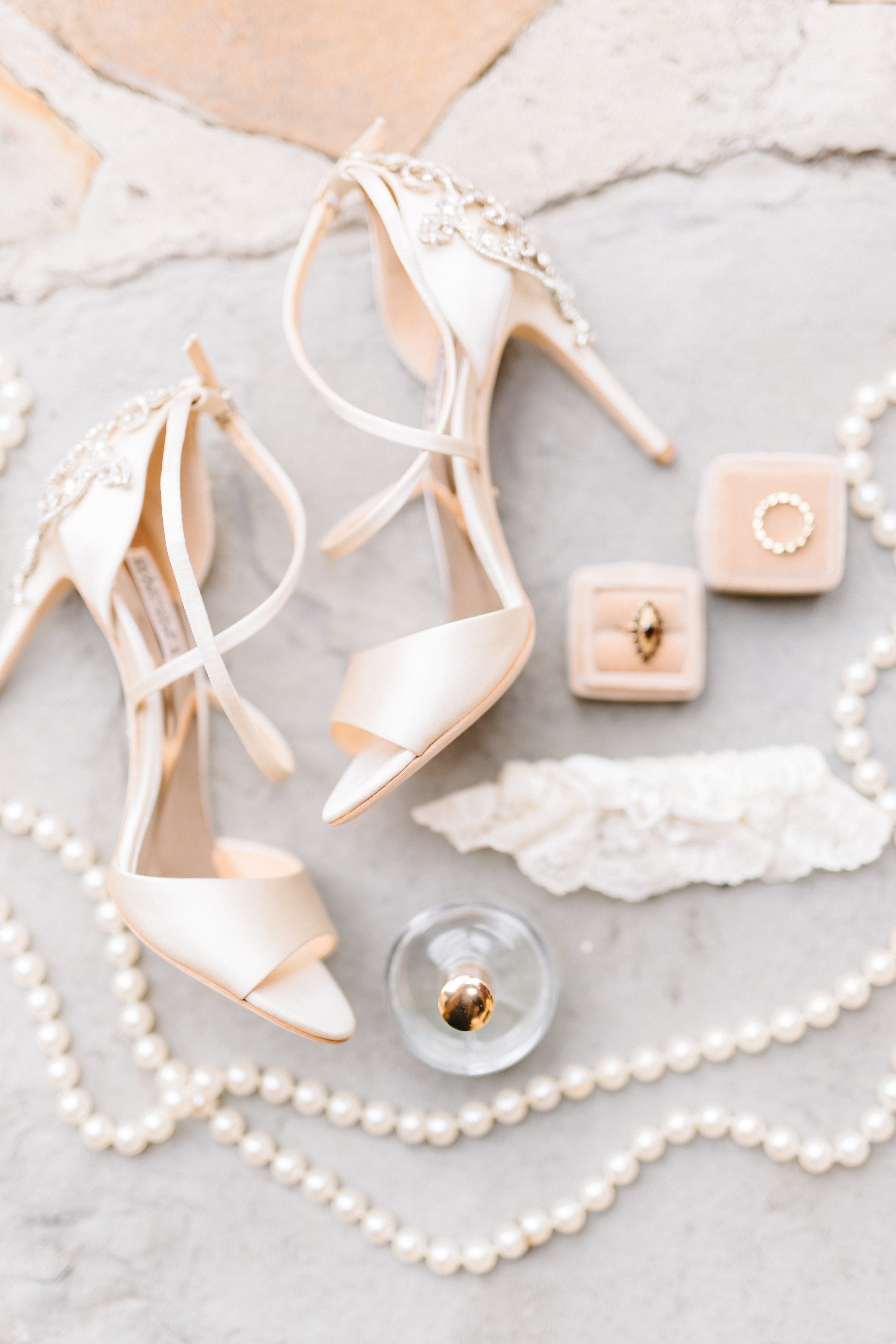 Satin, pearl, and lace wedding details  Orlando Wedding Planner Blue Ribbon Weddings  Orlando Wedding Photographer Emma Shourds Photography  Wedding Ceremony at Bell Tower at Bella Collina  Wedding Reception in Atrium at Bella Collina
