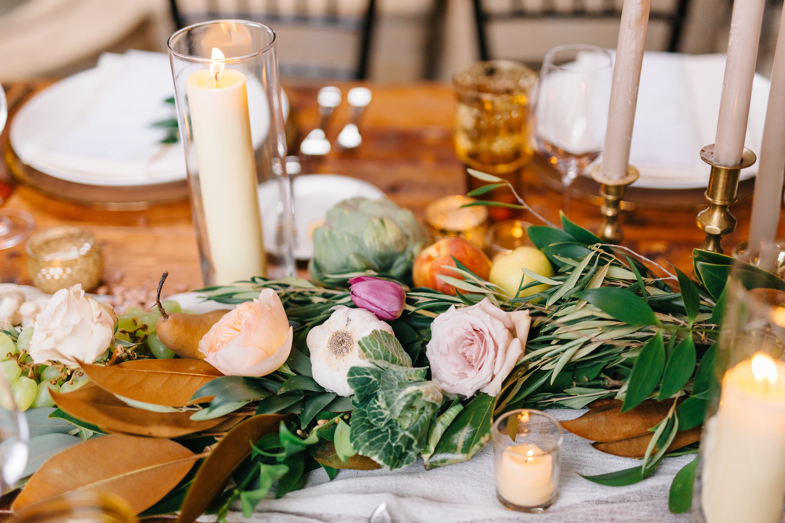 Candlelit tuscan inspired wedding reception with olive leaf and magnolia greenery  Orlando Wedding Planner Blue Ribbon Weddings  Orlando Wedding Photographer Emma Shourds Photography  Wedding Ceremony at Bell Tower at Bella Collina  Wedding Reception in Atrium at Bella Collina