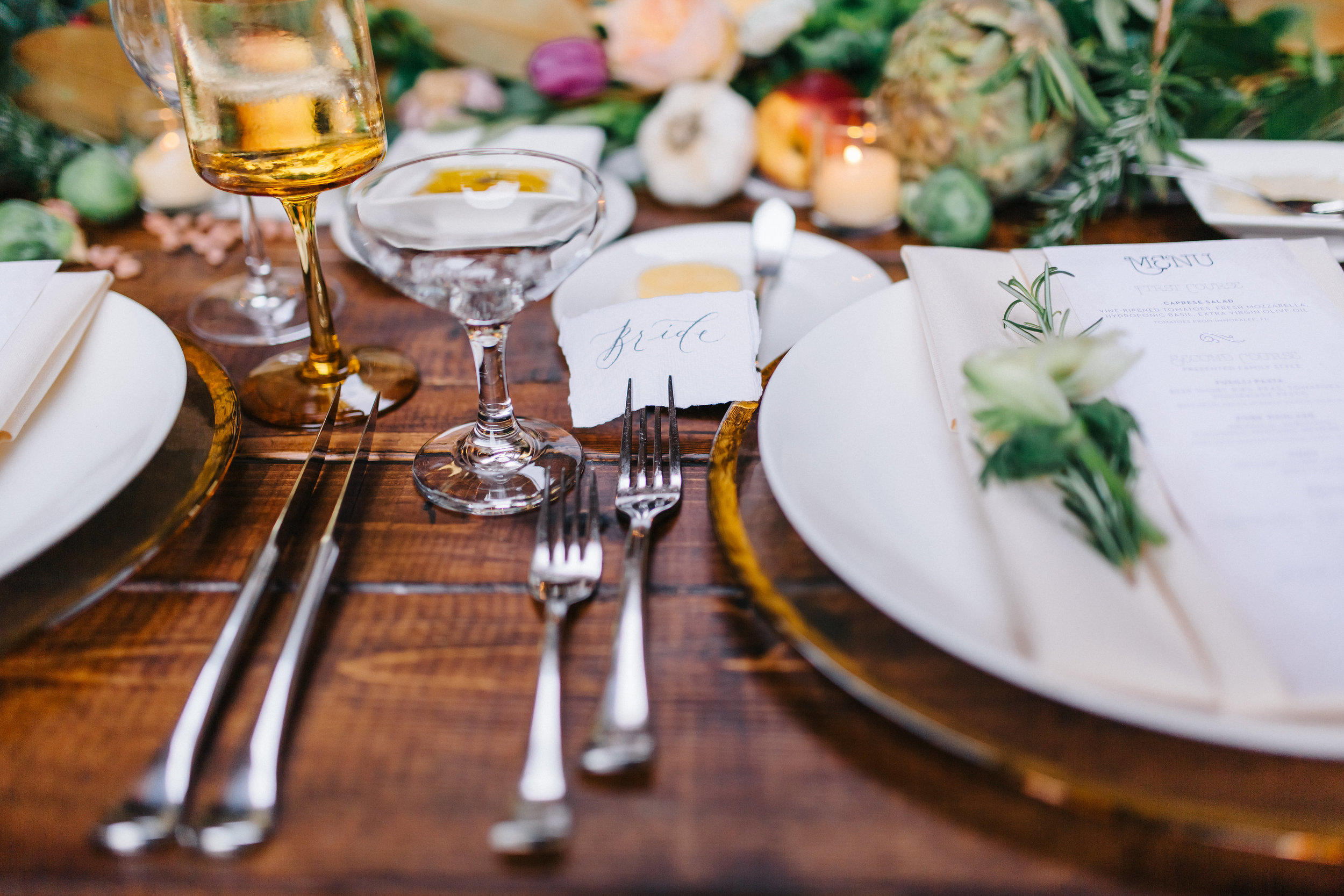 Candlelit tuscan inspired wedding reception with place cards  Orlando Wedding Planner Blue Ribbon Weddings  Orlando Wedding Photographer Emma Shourds Photography  Wedding Ceremony at Bell Tower at Bella Collina  Wedding Reception in Atrium at Bella Collina