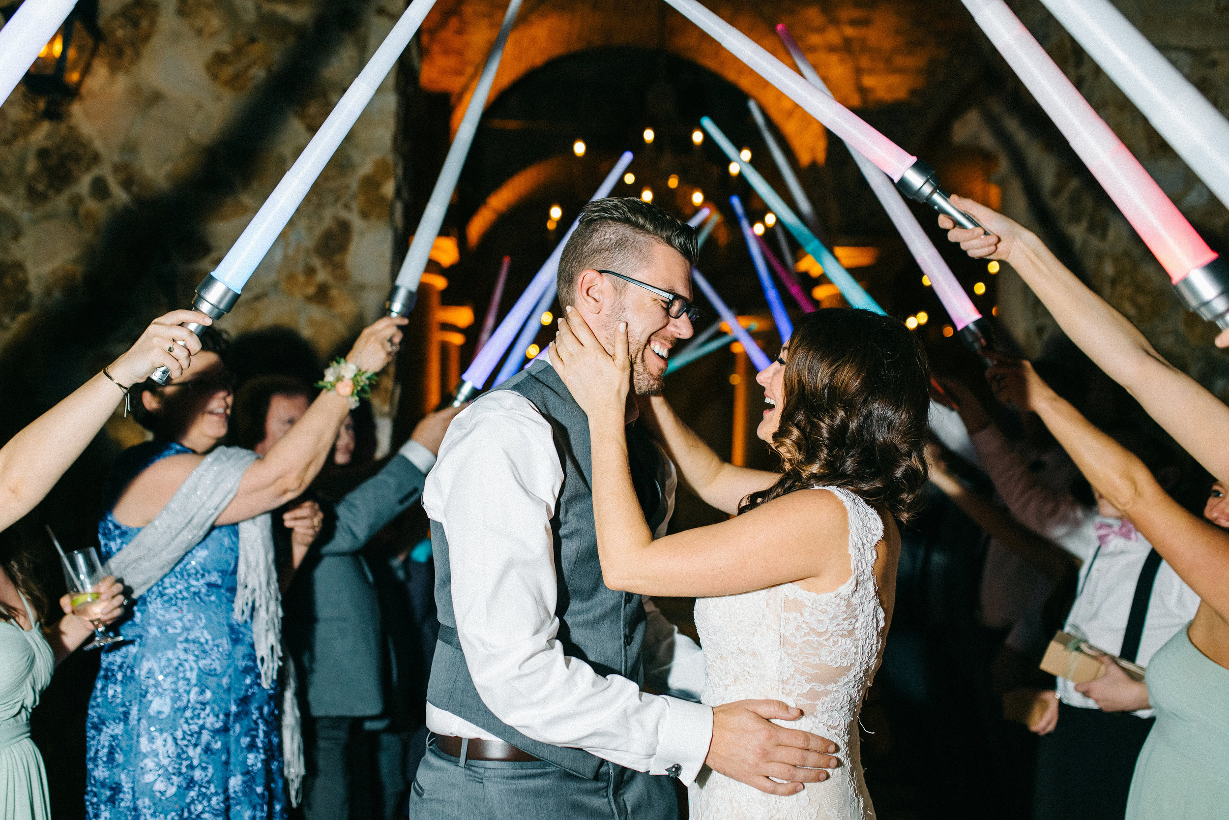 Light Saber Grand Exit for the Newlyweds   Orlando Wedding Planner Blue Ribbon Weddings  Orlando Wedding Photographer Emma Shourds Photography  Wedding Ceremony at Bell Tower at Bella Collina  Wedding Reception in Atrium at Bella Collina