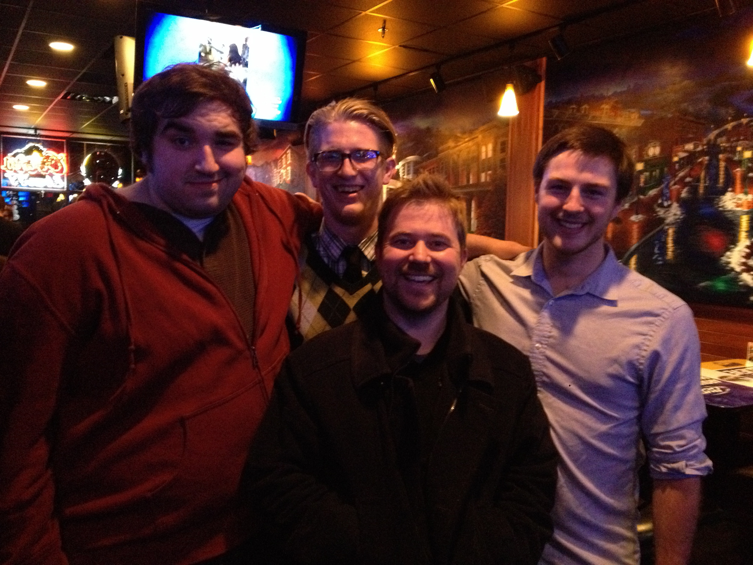 Brothers in Song: Drew Stevens (left), Ben Schmidt, (center), & Dylan Schulte (right) with Dr. Wiles (short).