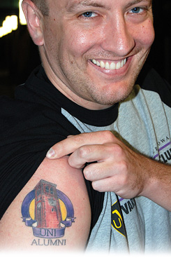 """Glee Club Alumnus Brendon Snell   (UNI, '04) shows extraordinarydevotion to his alma mater with a very real """"UNI Alumni"""" tattoo."""