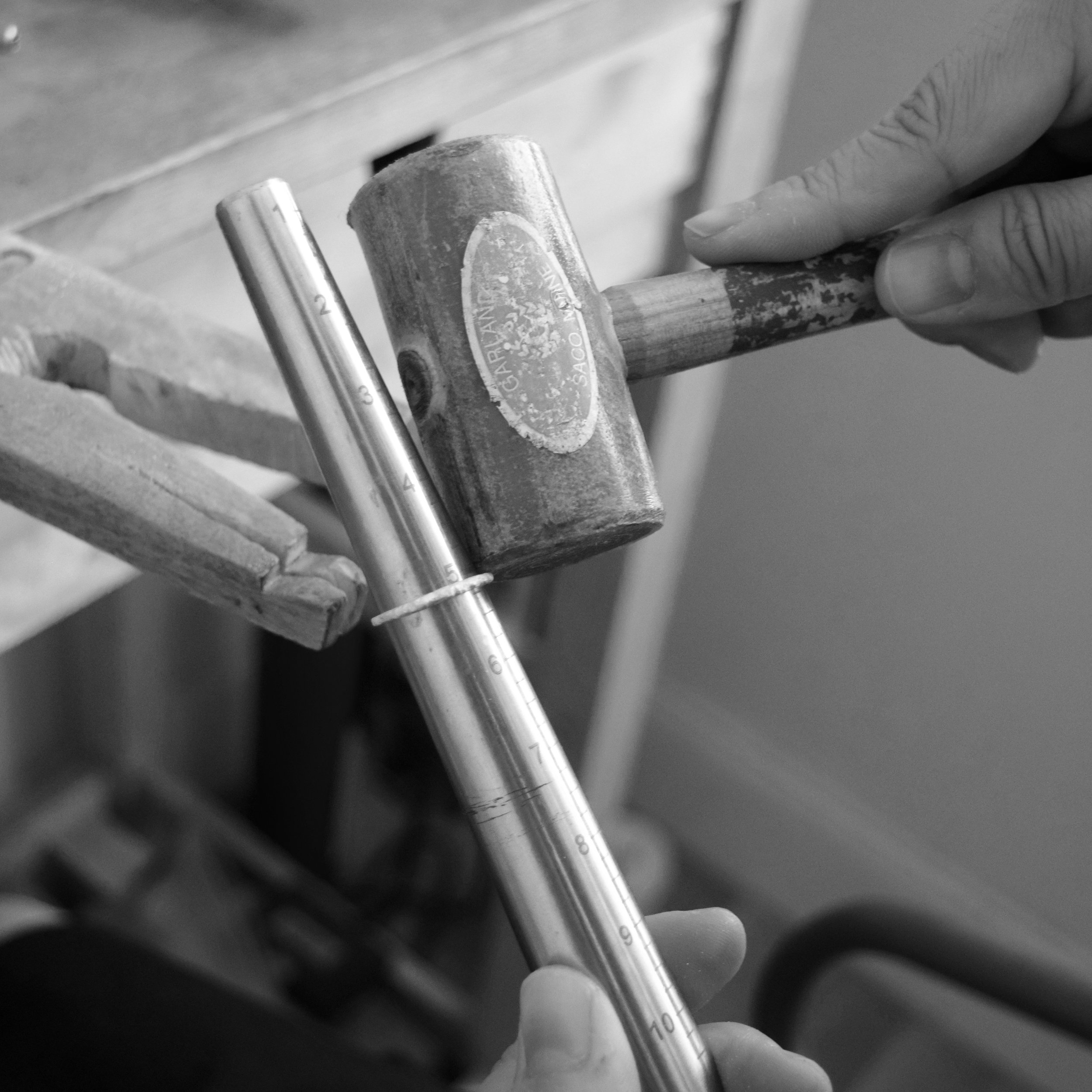 3. Since a ring typically shrinks during casting, we gently hammer it down a mandrel with a raw hide mallet to enlarge it.