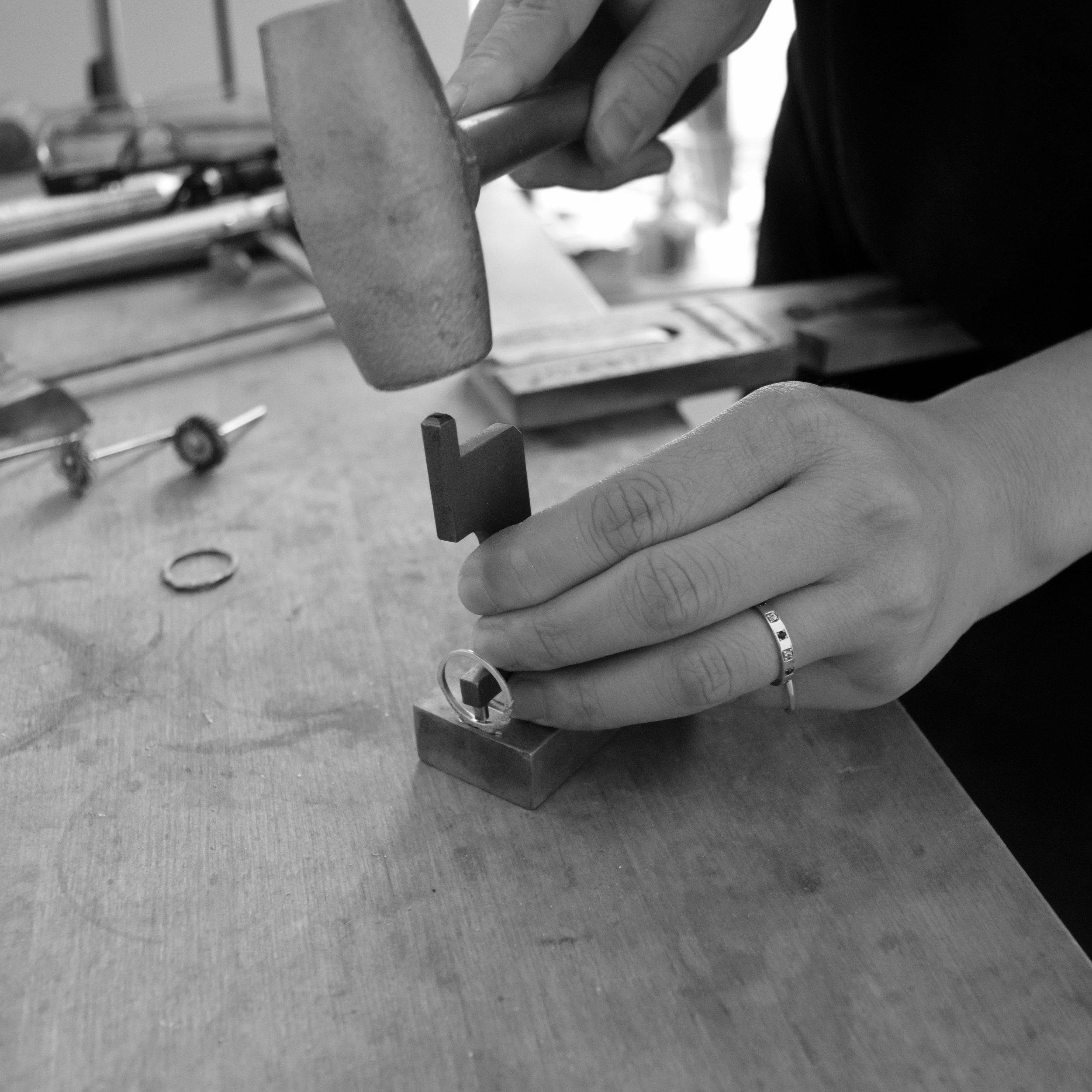 7. We then stamp the ring's inside to mark its metal content.