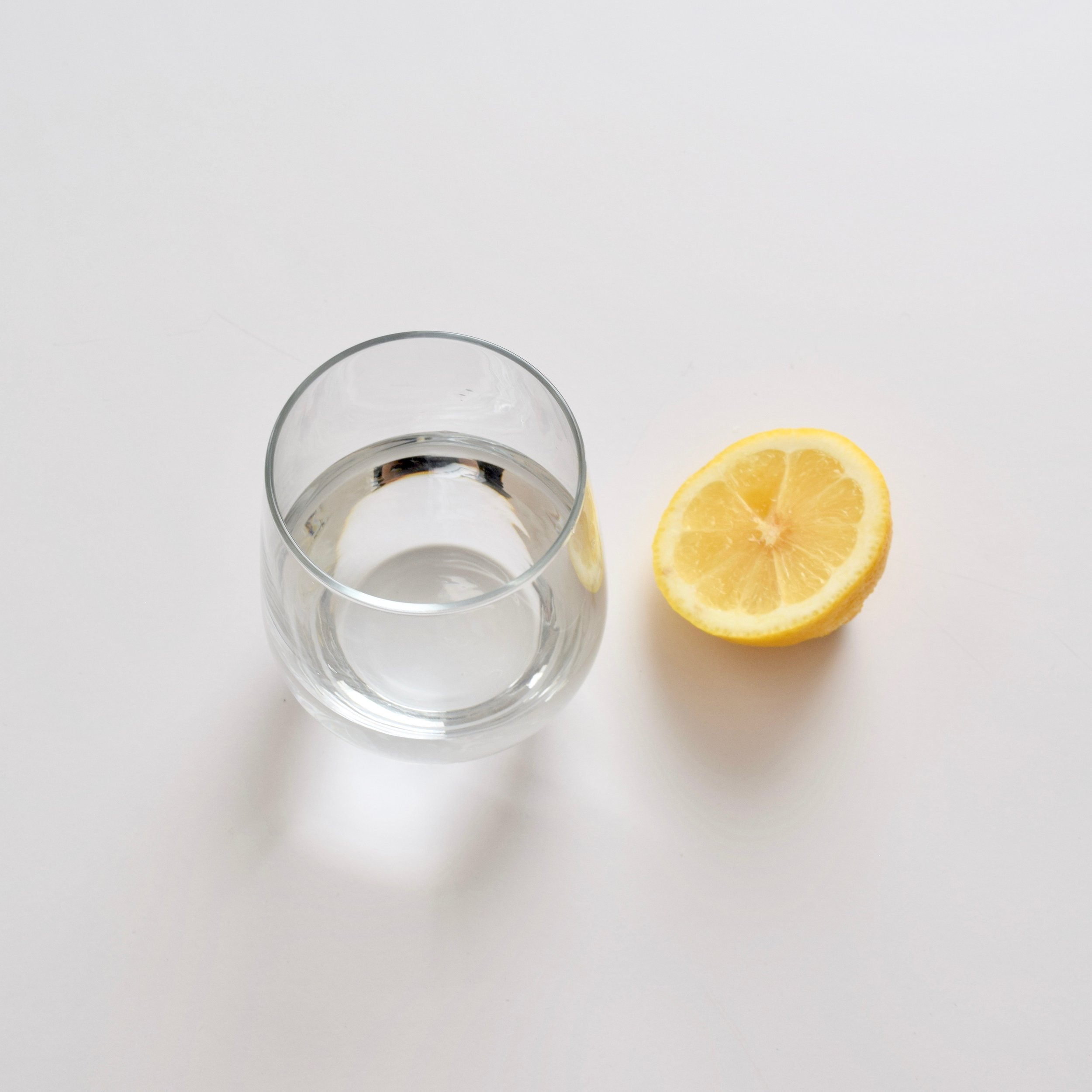 Step 1: Fill a cup with some warm water and add a squeeze of lemon juice.