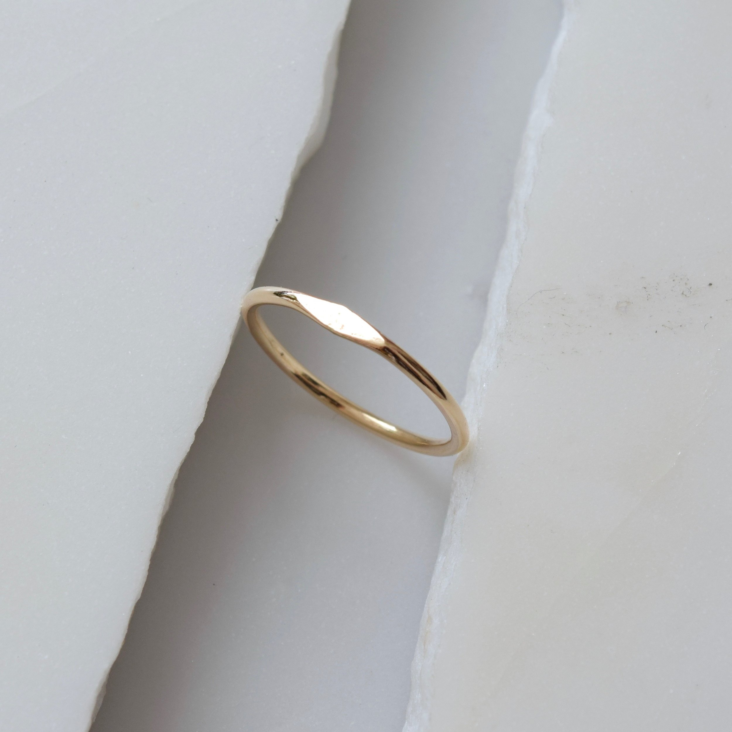 A solid gold ring because she has a heart of gold.