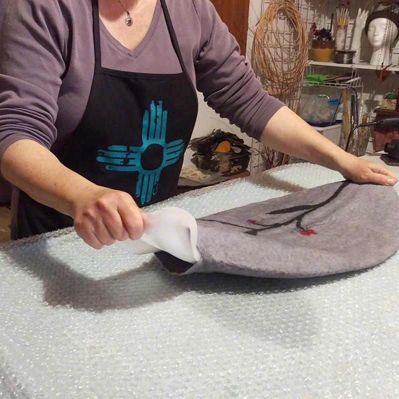 Karen making a wet felted vessel in her studio.