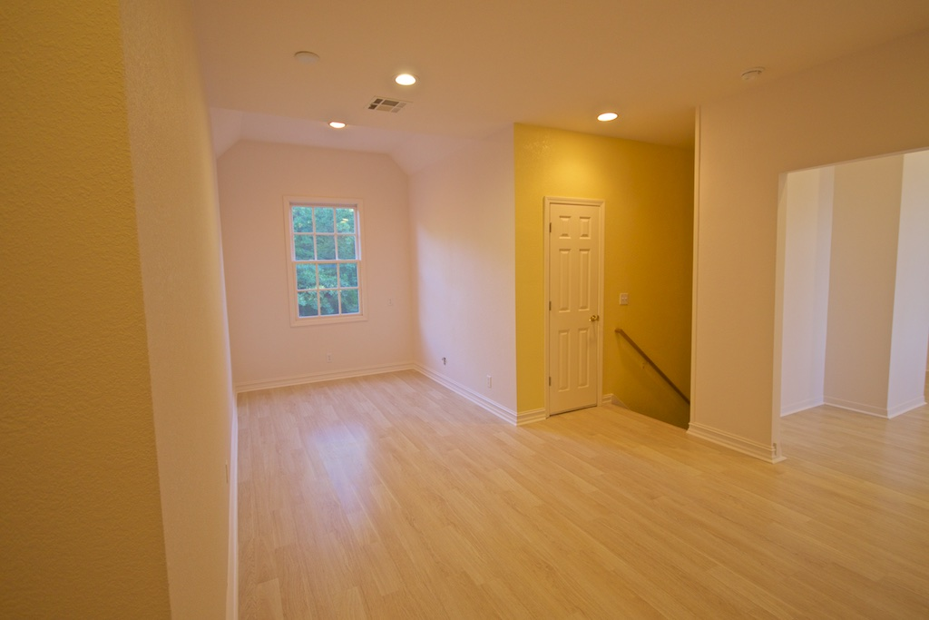 Just around the corner and to the left. New area, was part of bedroom, will be a gallery/sitting area. Don't ask about that yellow stair wall. It's actually not that bright and is more of a straw, but still, don't ask.