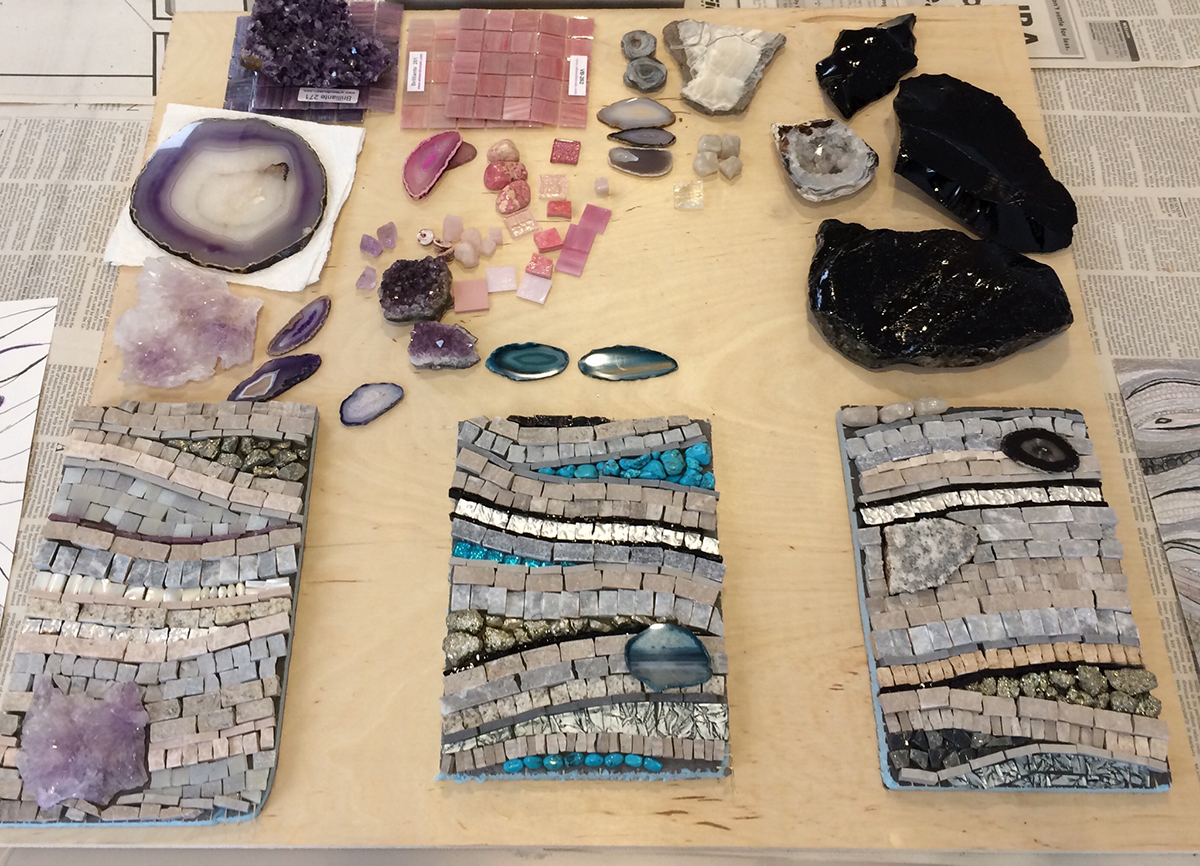 """Three examples, approx. 9"""" x 6"""" each, to illustrate possibilities for a residential commission. The pieces are not glued down so the work looks a bit wobbly and not terribly refined. Each example has some pyrite—the darkish, grayish nuggets—but the camera did not capture the sparkle. Oh yes, I've been having fun!"""