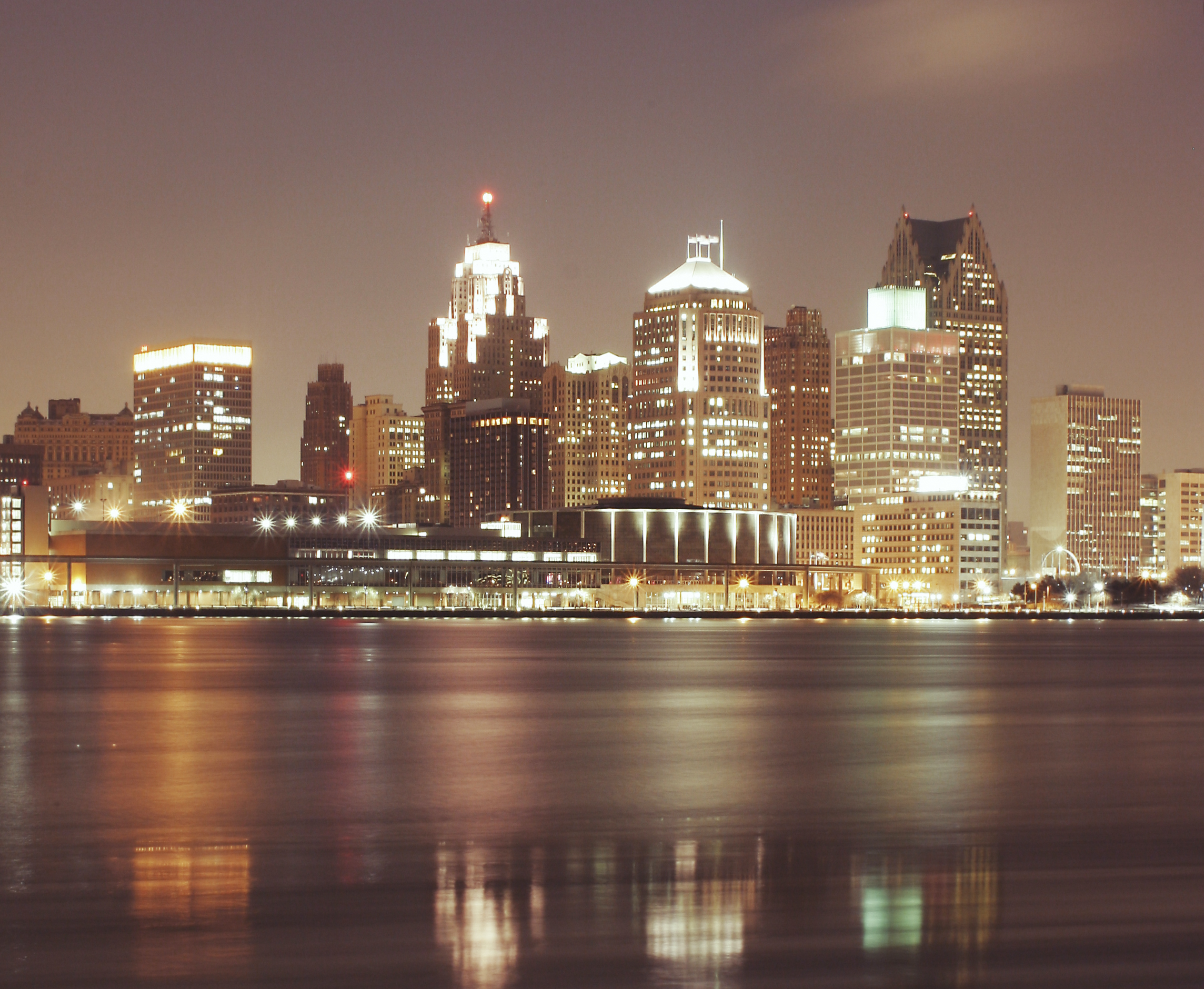 Dominion has office in metro-Detroit showing big buildings with lights on at night.