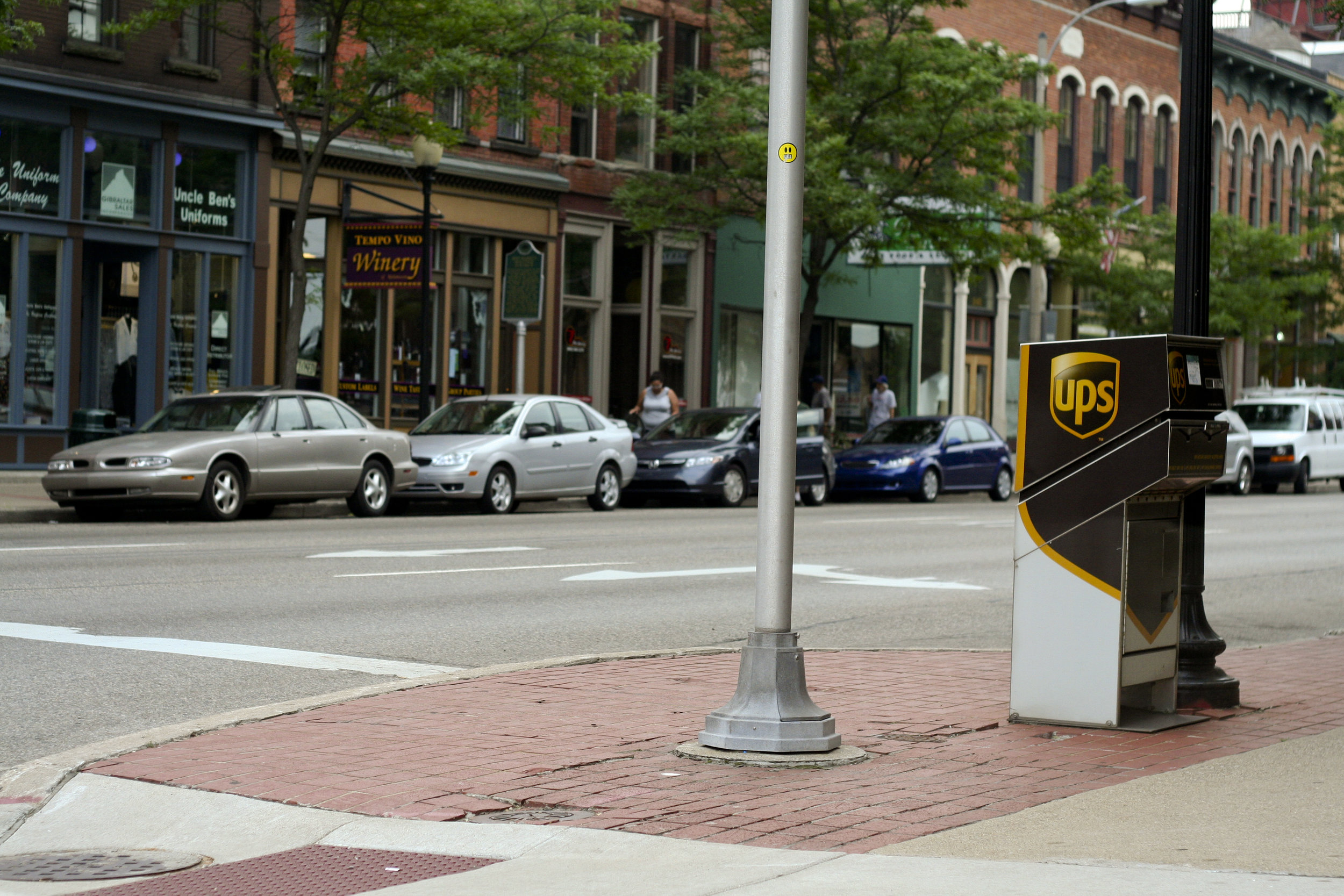 Dominion is local to Kalamazoo organizations showing UPS mailbox and cars in the street of a main street in the city.
