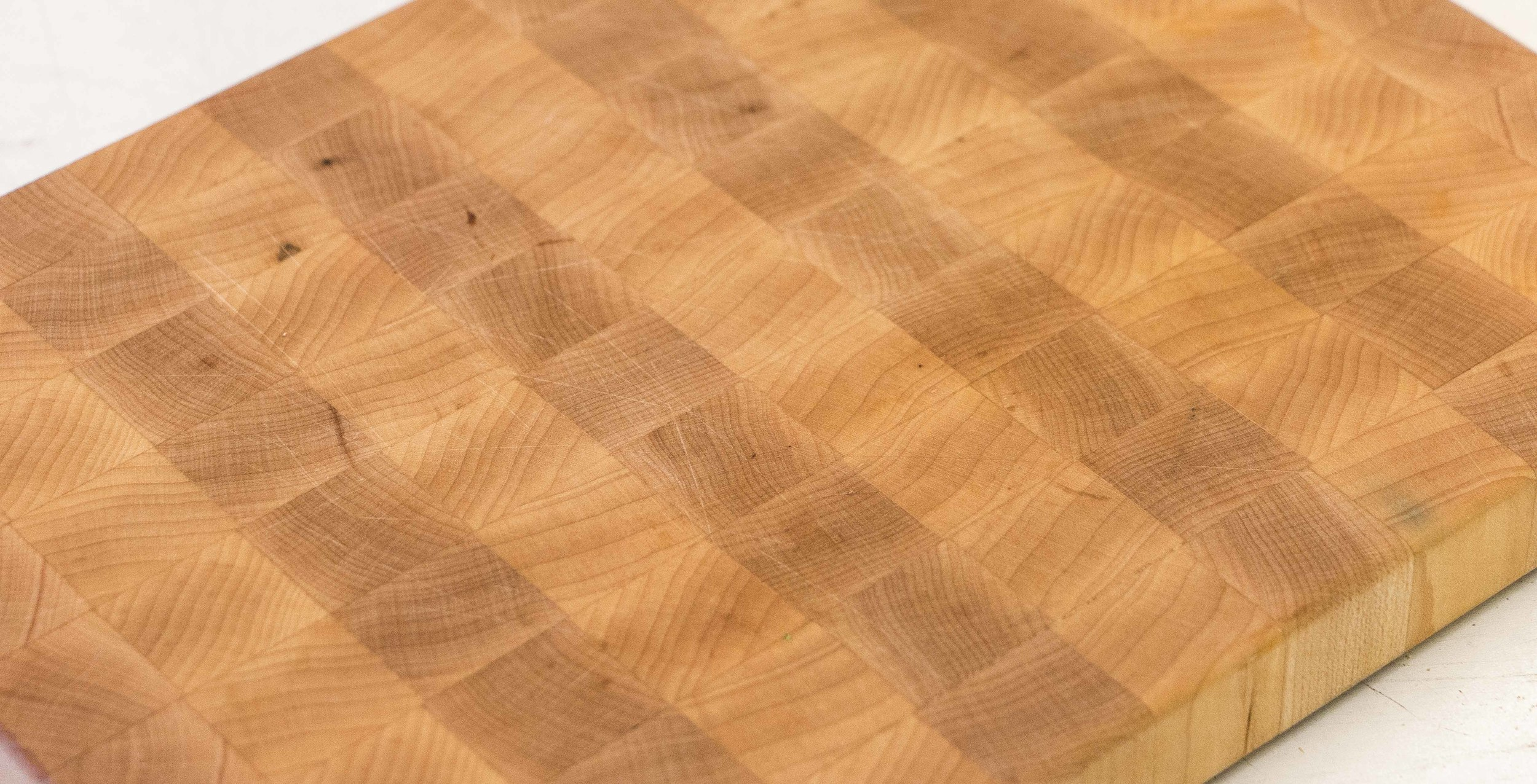 cutting board after sanding and knife marks removed reveals a brand new cutting board