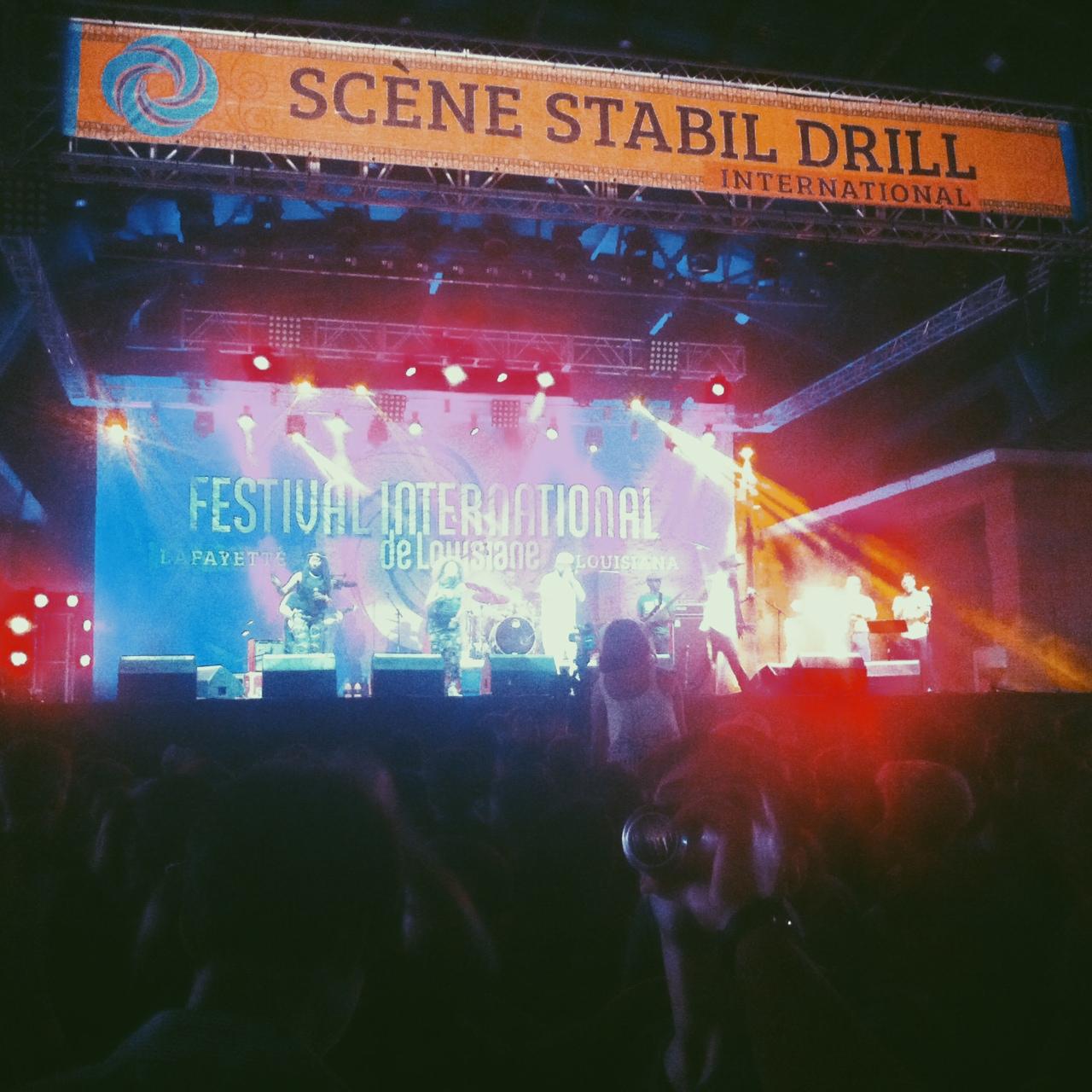 Nomadic Massive performing at Festival International de Louisiane, 2015